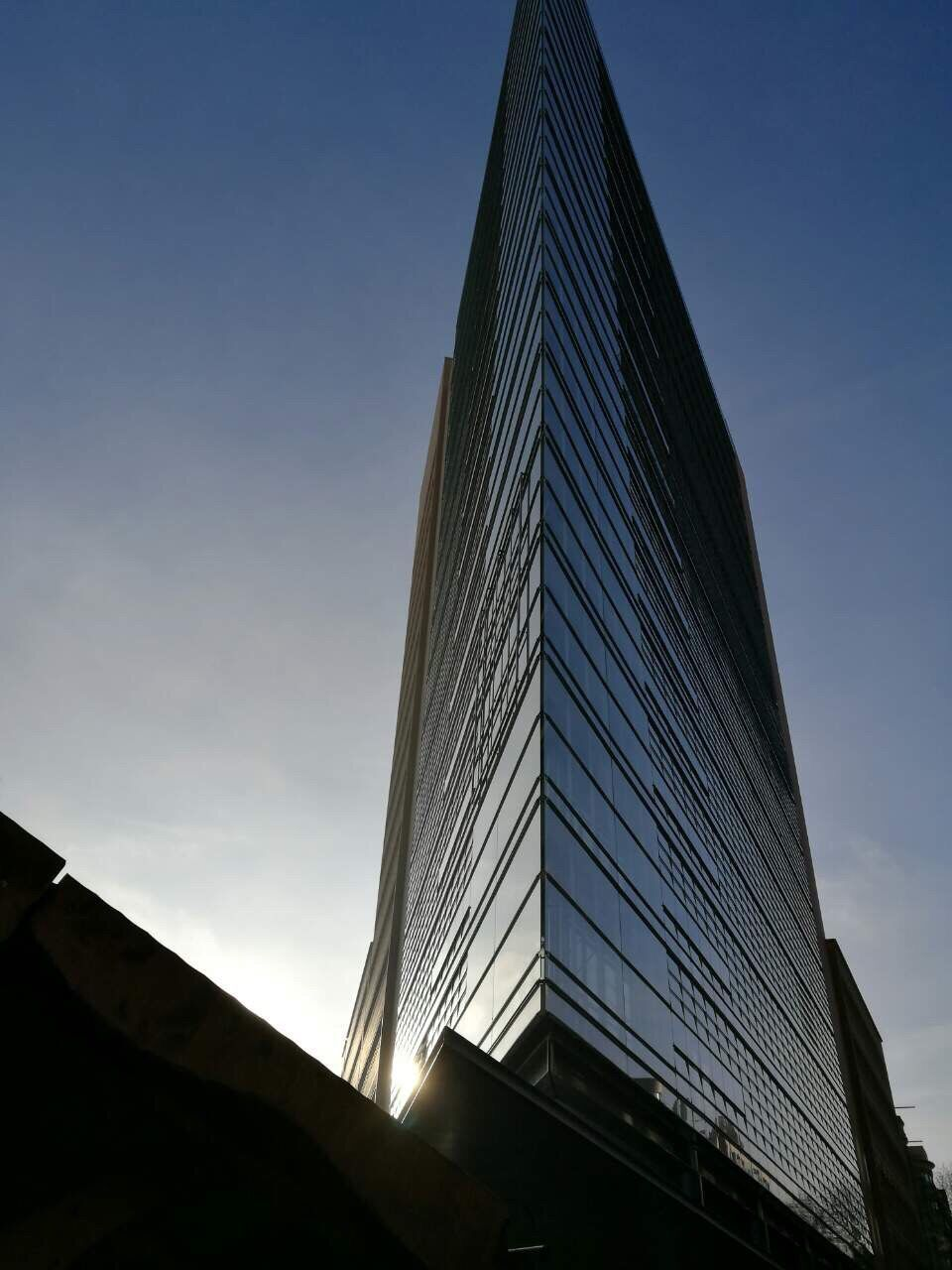 architecture, built structure, modern, low angle view, building exterior, sky, no people, skyscraper, day, clear sky, outdoors, futuristic