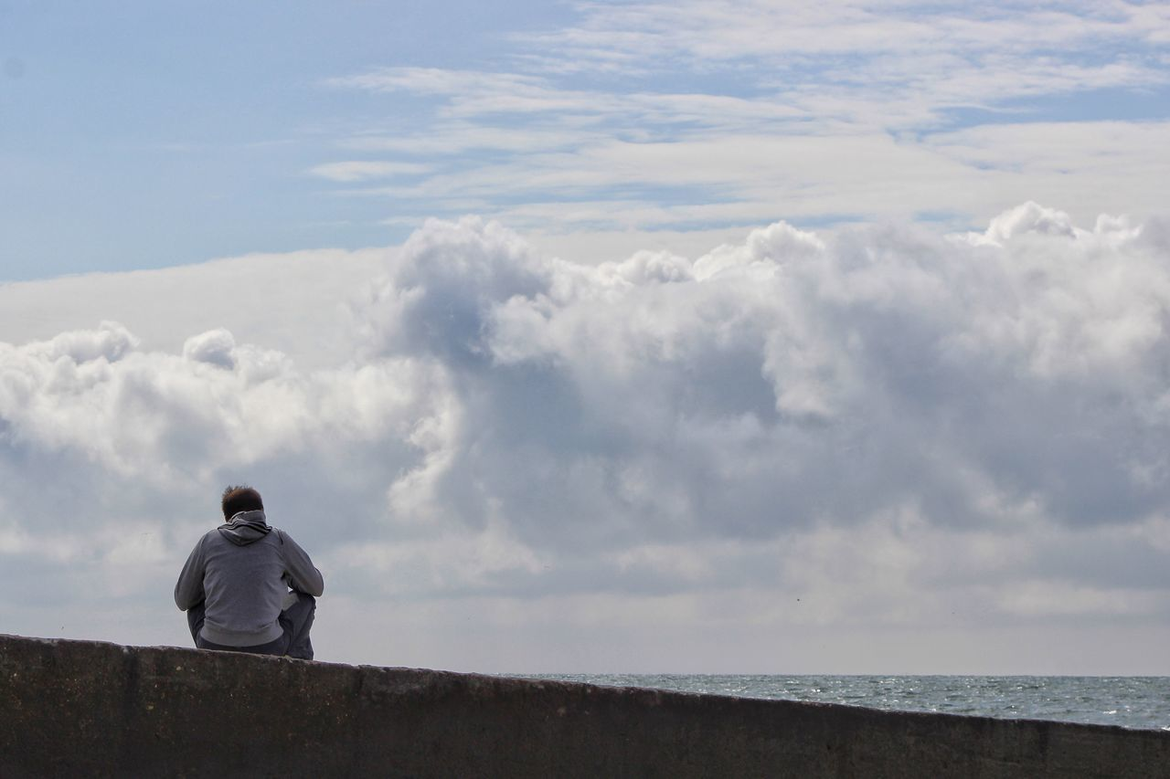 Thinking of future Sky Rear View Cloud - Sky Real People Nature Lifestyles Men One Person Leisure Activity Beauty In Nature Full Length Standing Outdoors Scenics Day Sea Water Looking Ahead Looking Away Sitting Man At The Beach Looking At Sky Lines Horizon Over Water The Great Outdoors - 2017 EyeEm Awards