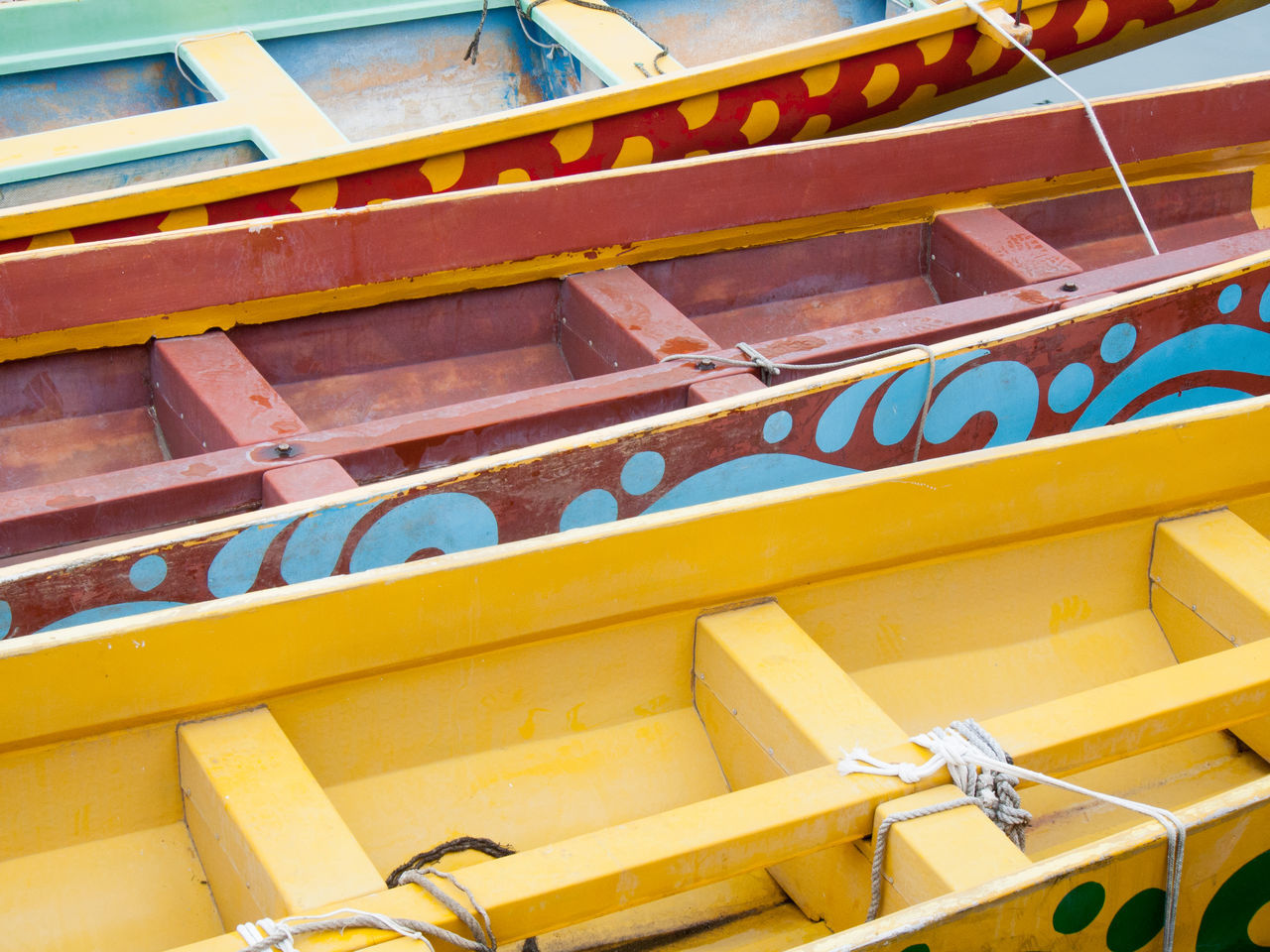 Part of wooden canoes Abstract Canoes Close-up Colourful Day Horizontal Kayak Looking Down No People Outdoors Part Of Wood Wooden Wooden Canoe Yellow