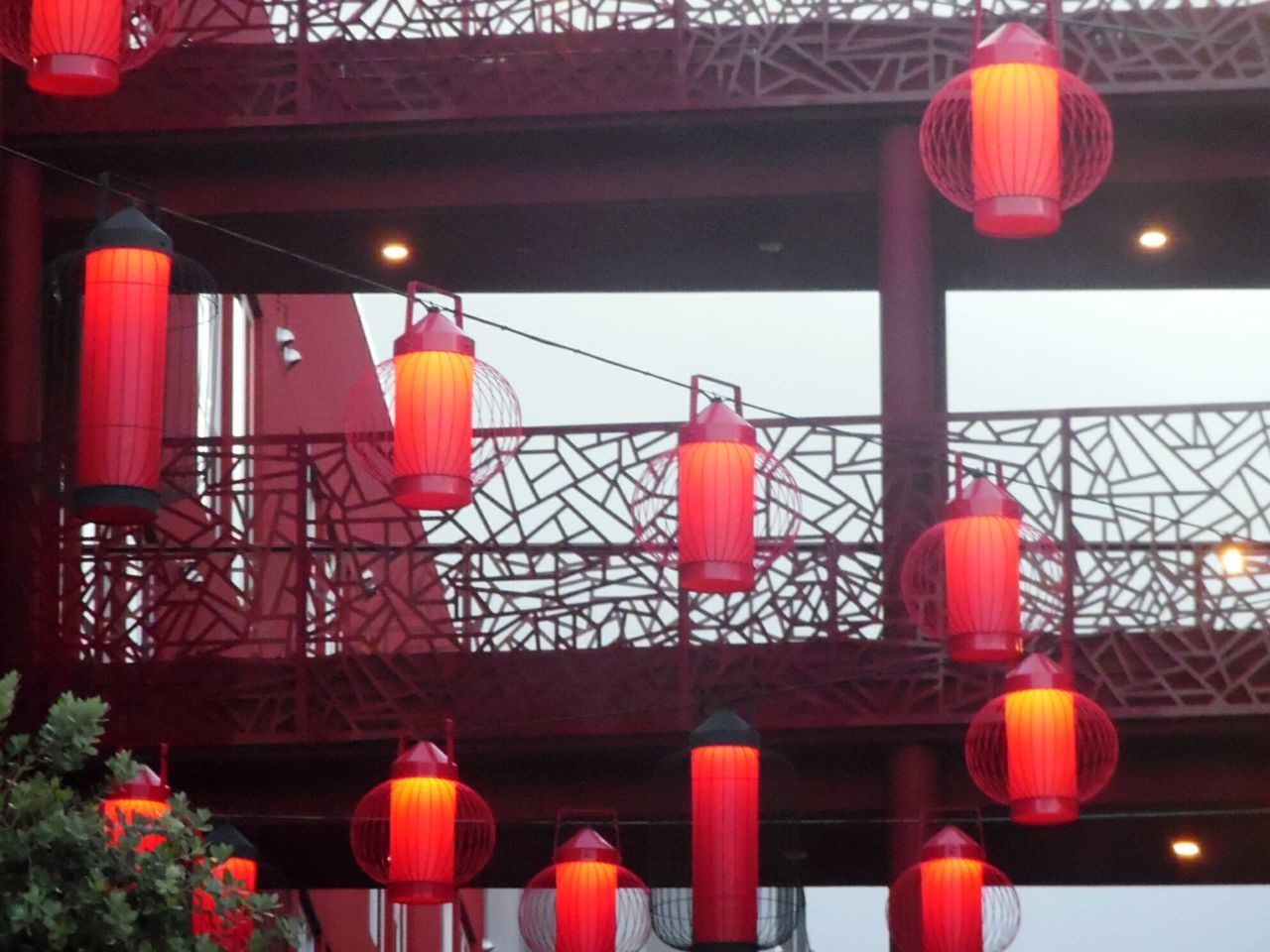 lighting equipment, lantern, hanging, illuminated, chinese lantern, low angle view, paper lantern, no people, red, built structure, architecture, chinese lantern festival, indoors, day, close-up