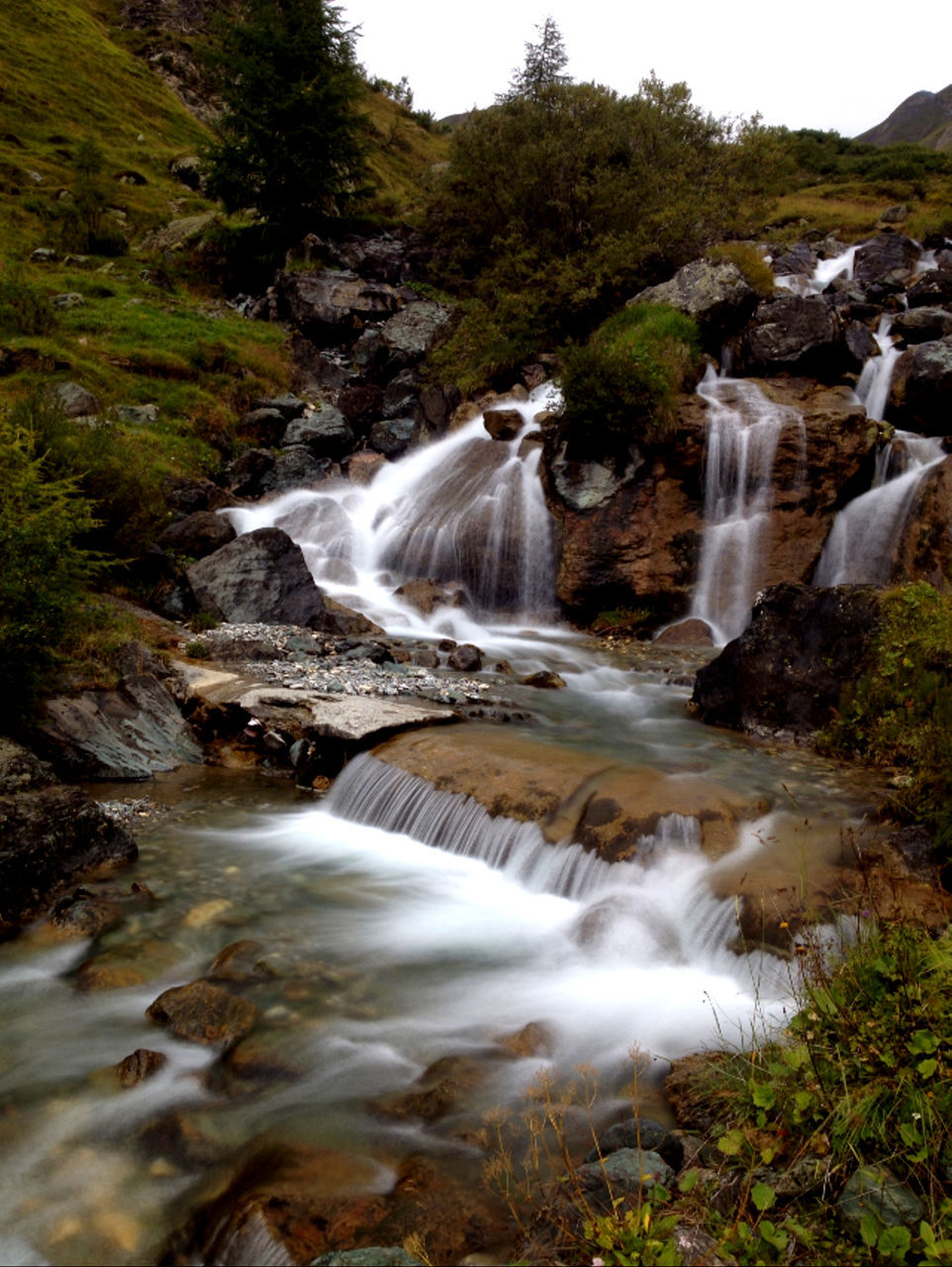motion, waterfall, long exposure, water, flowing water, blurred motion, nature, beauty in nature, scenics, no people, outdoors, day, river, tranquility, forest, tree, power in nature, sky