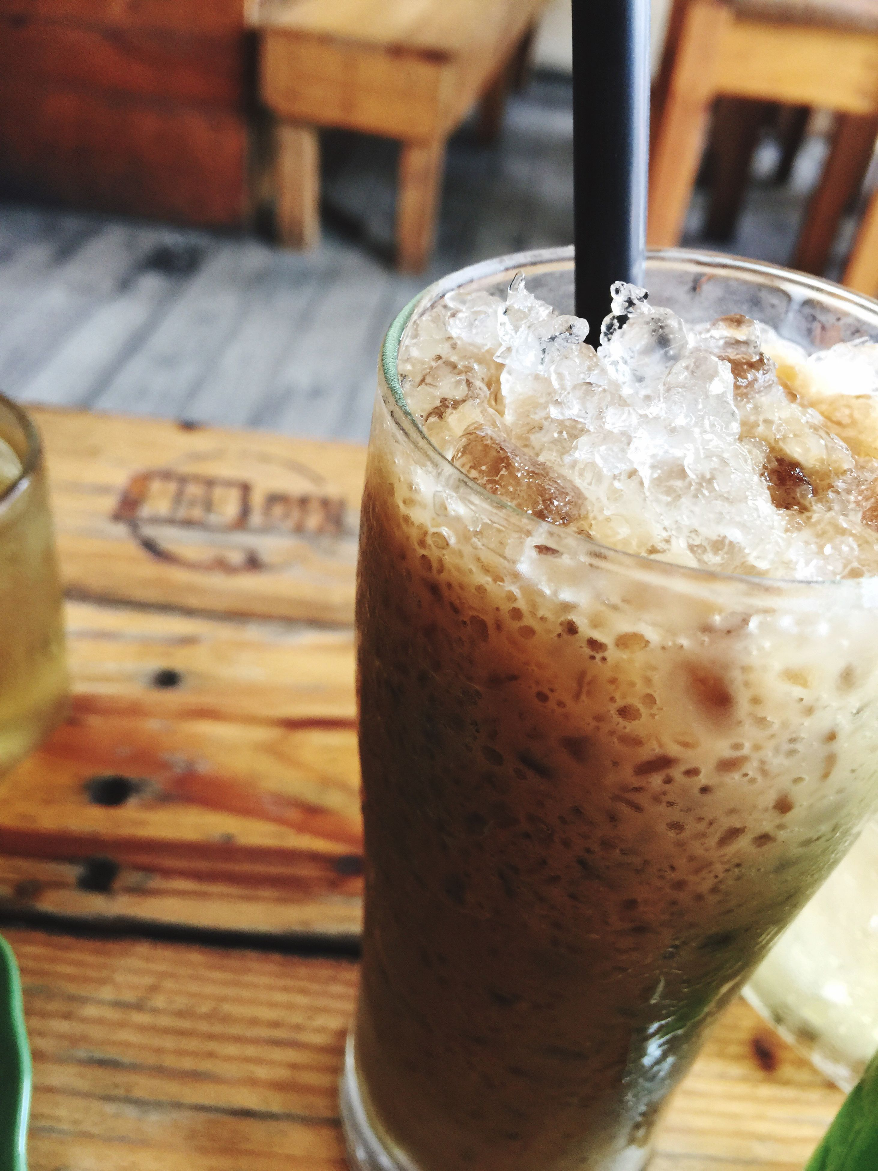 food and drink, drink, refreshment, indoors, freshness, table, drinking glass, close-up, still life, alcohol, frothy drink, focus on foreground, drinking straw, coffee - drink, beer glass, glass - material, wood - material, healthy eating, beverage, food