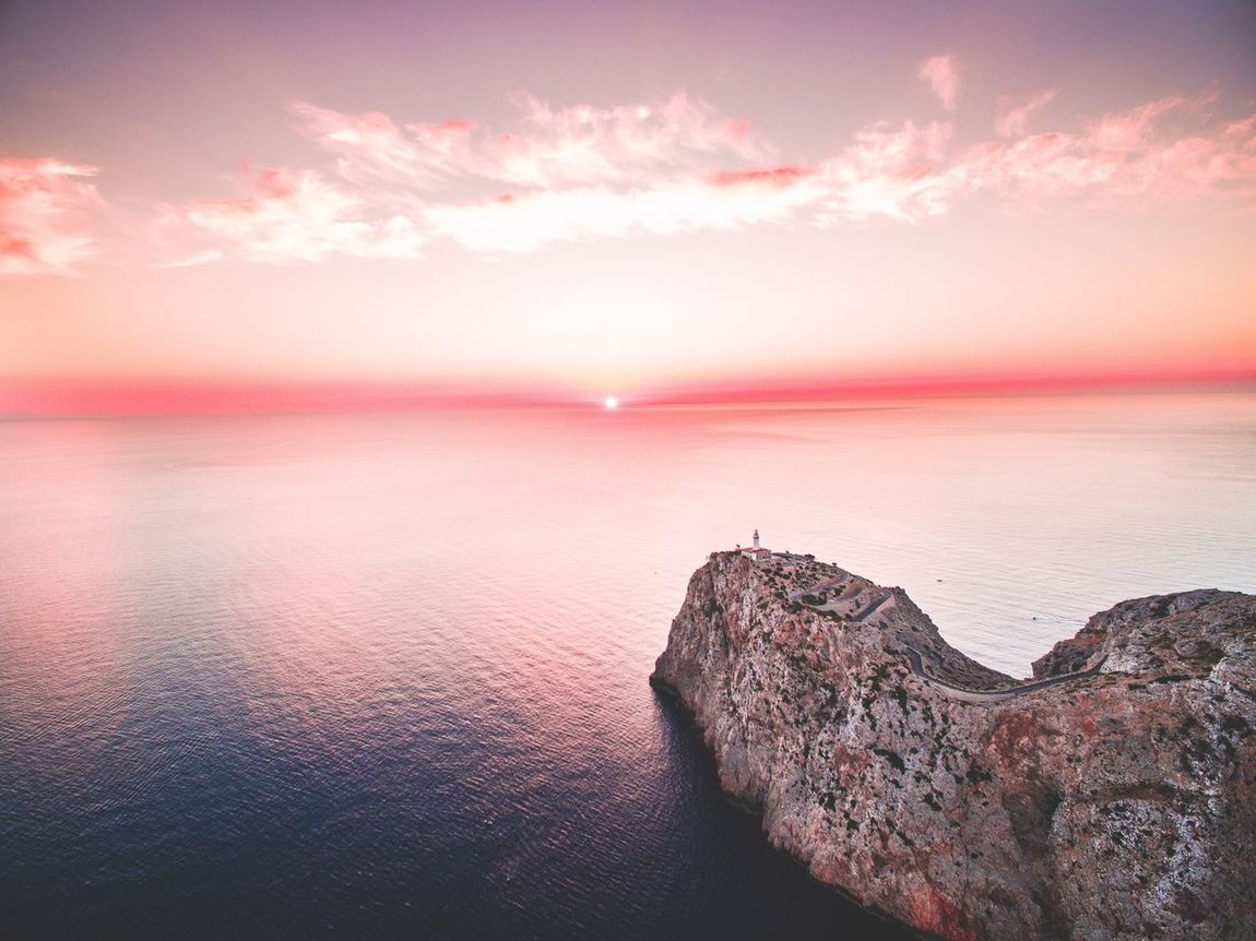 Catching the sunrise sitting on the cliffs of Cap Formentor on Mallorca. Sea Sunrise Seascape Ocean Drone  Areal A Bird's Eye View