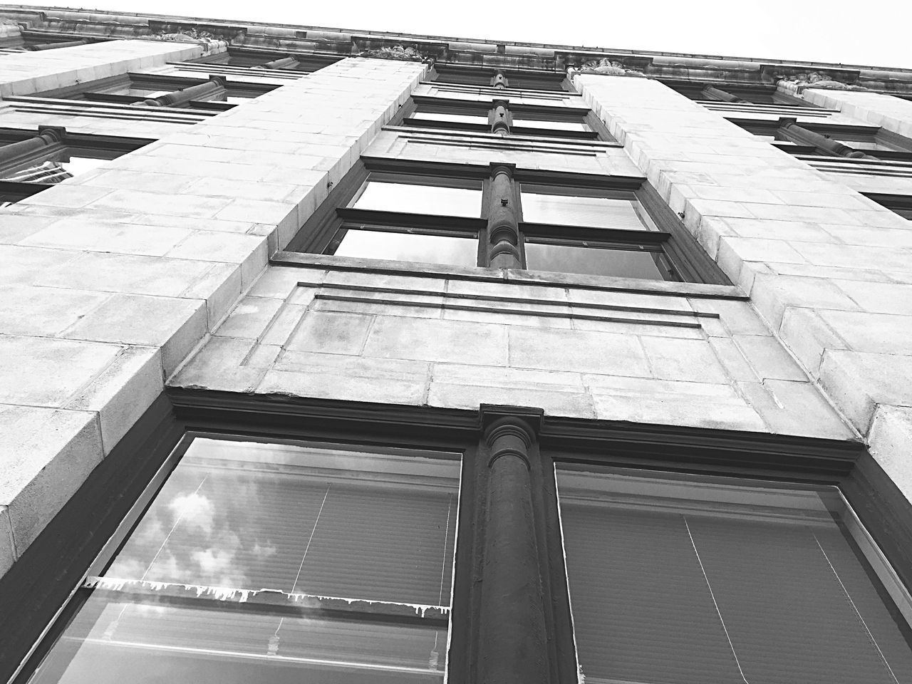 low angle view, architecture, built structure, building exterior, day, outdoors, no people, sky