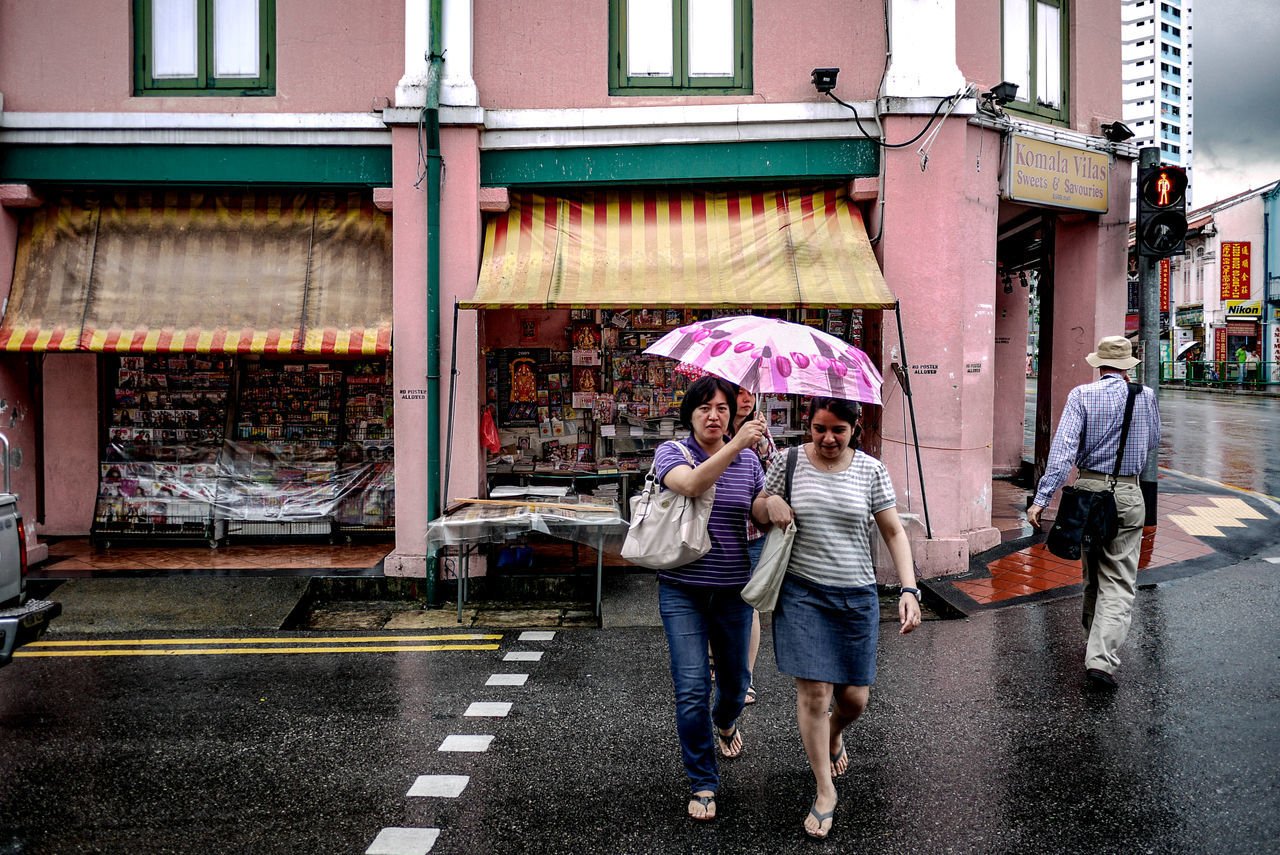 Walking Women Lifestyles City Life Outdoors Adults Only People Architecture Heritage Building Umbrella Rain Traffic Light  Crossing Road Street Photography Streetphotography Streetphoto_color Streetlife Street Life Everybodystreet Panasonic GF1