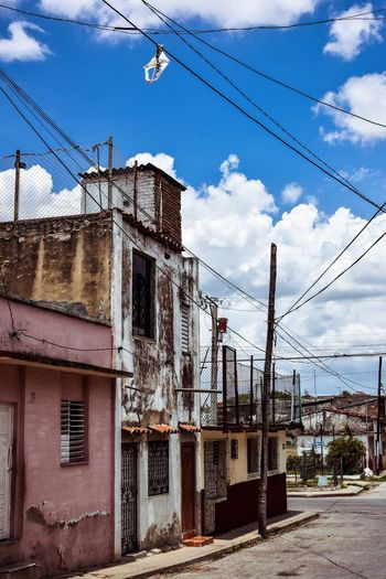 Cable Sky Architecture Power Line  Building Exterior Built Structure Cloud - Sky Day Outdoors Electricity Pylon Telephone Line No People City Cuba Santa Clara Cuba The Street Photographer - 2017 EyeEm Awards