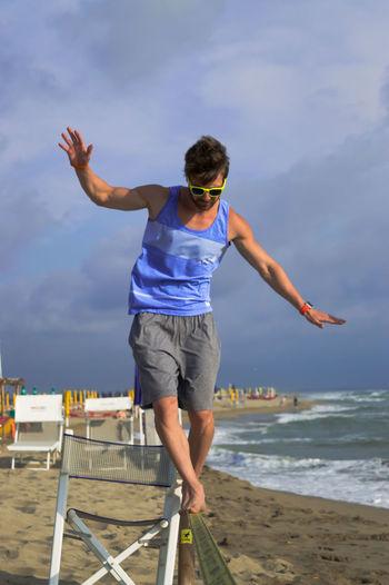Activity Balance Beach Casual Clothing Fun Guy Outdoors Sea Shore Slackline Sport Summer People Of The Oceans Viareggio Italy Natural Light Portrait Athleisure Uniqueness