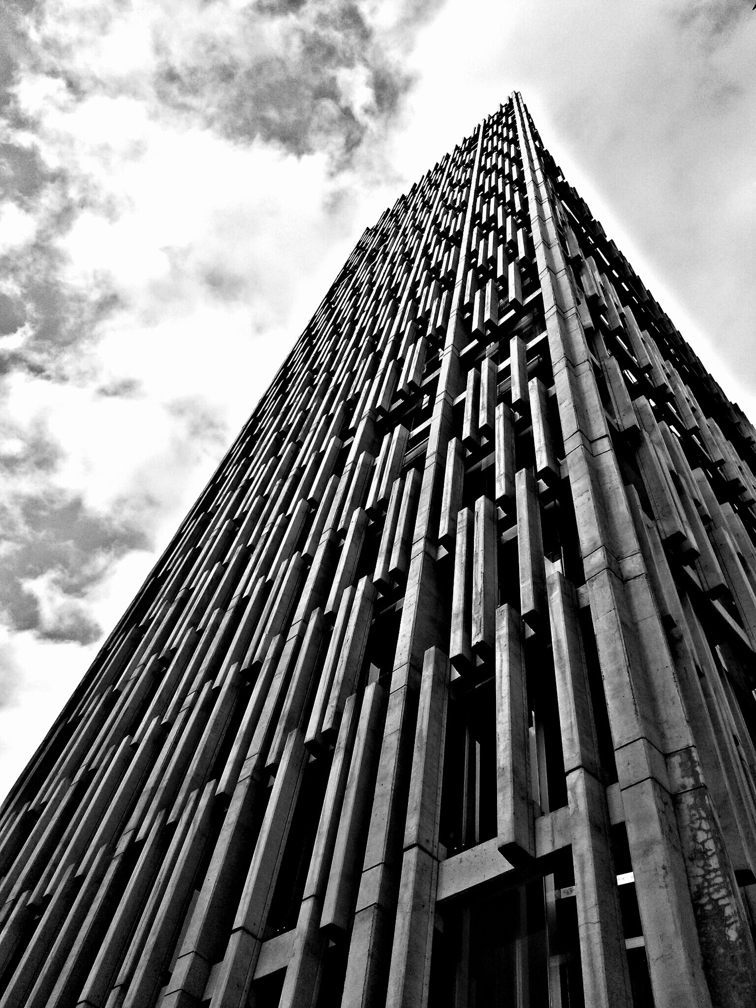 architecture, low angle view, built structure, building exterior, sky, tall - high, cloud - sky, tower, modern, skyscraper, cloudy, office building, city, cloud, tall, building, day, outdoors, no people, glass - material