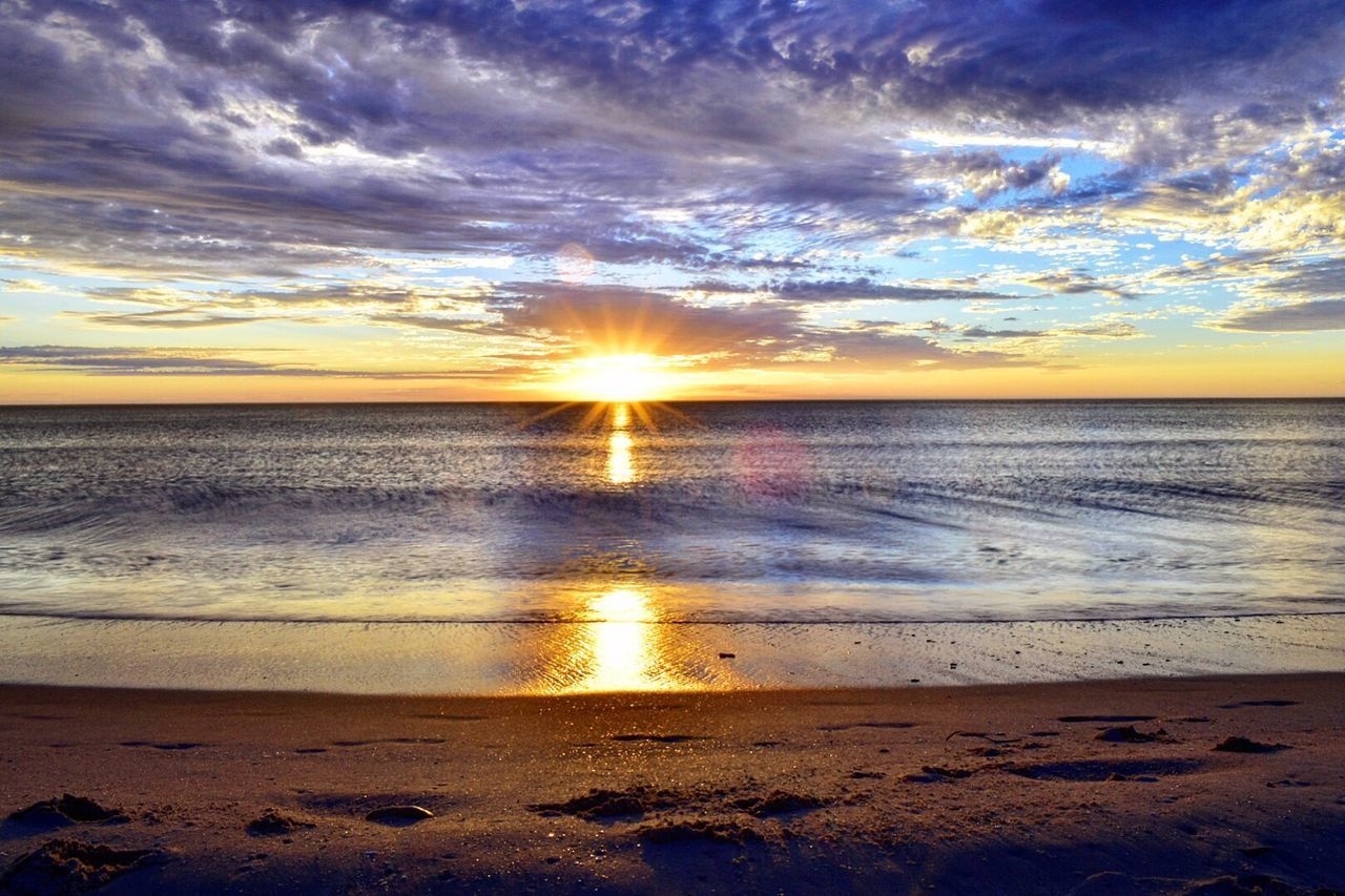 Sea Beach Water Tranquil Scene Beauty In Nature Nature Scenics Horizon Over Water Sand Sky Sunset Sun Shore Tranquility Reflection Sunlight Cloud - Sky Outdoors Sunbeam No People