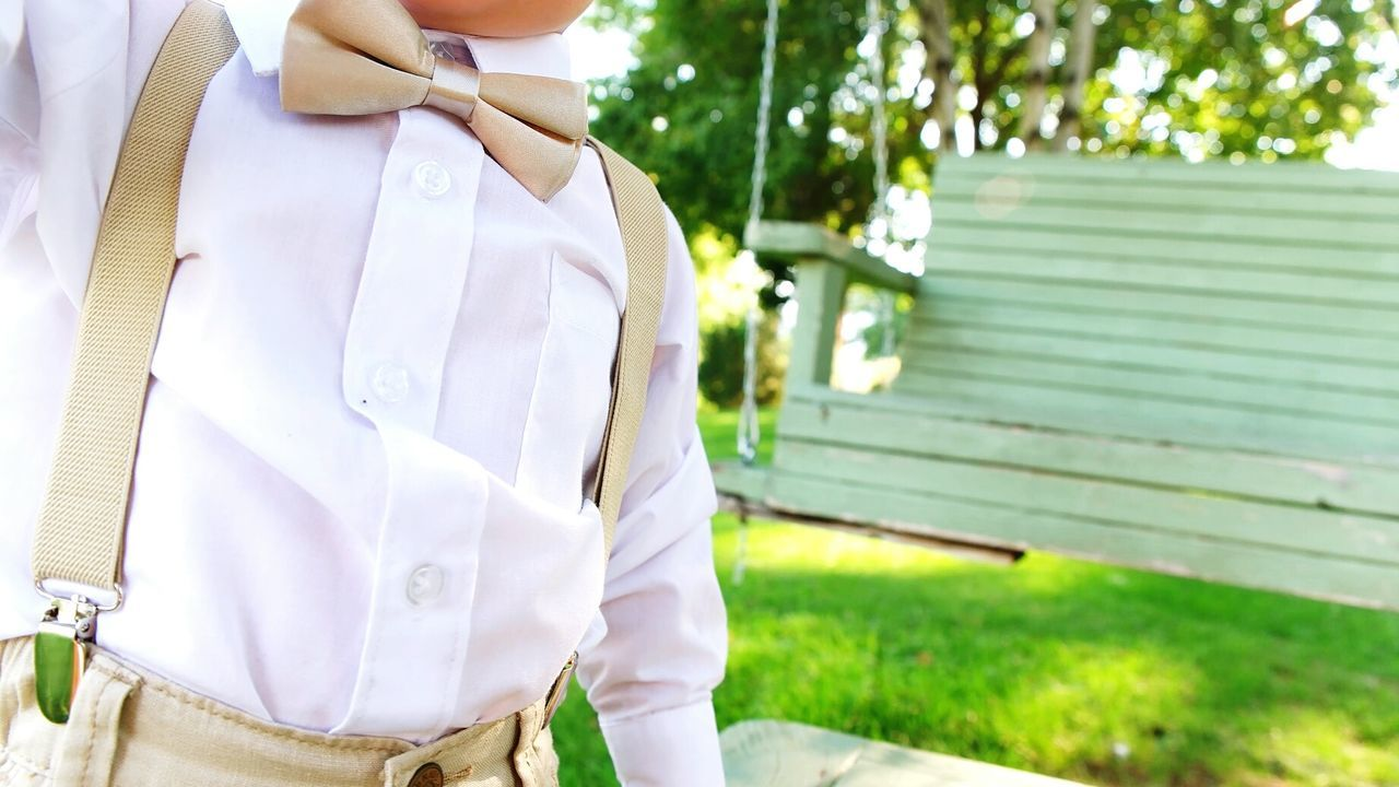 Close-up Outdoors Wedding Photography Weddinginspiration Weddingday  Wedding Photos Weddings Wedding Details Wedding Day Marriage  Ring Bearer Bowtie Bow Tie Wedding No Face Cute Boy Child Childhood Boy Belly Suspenders Dressed Up