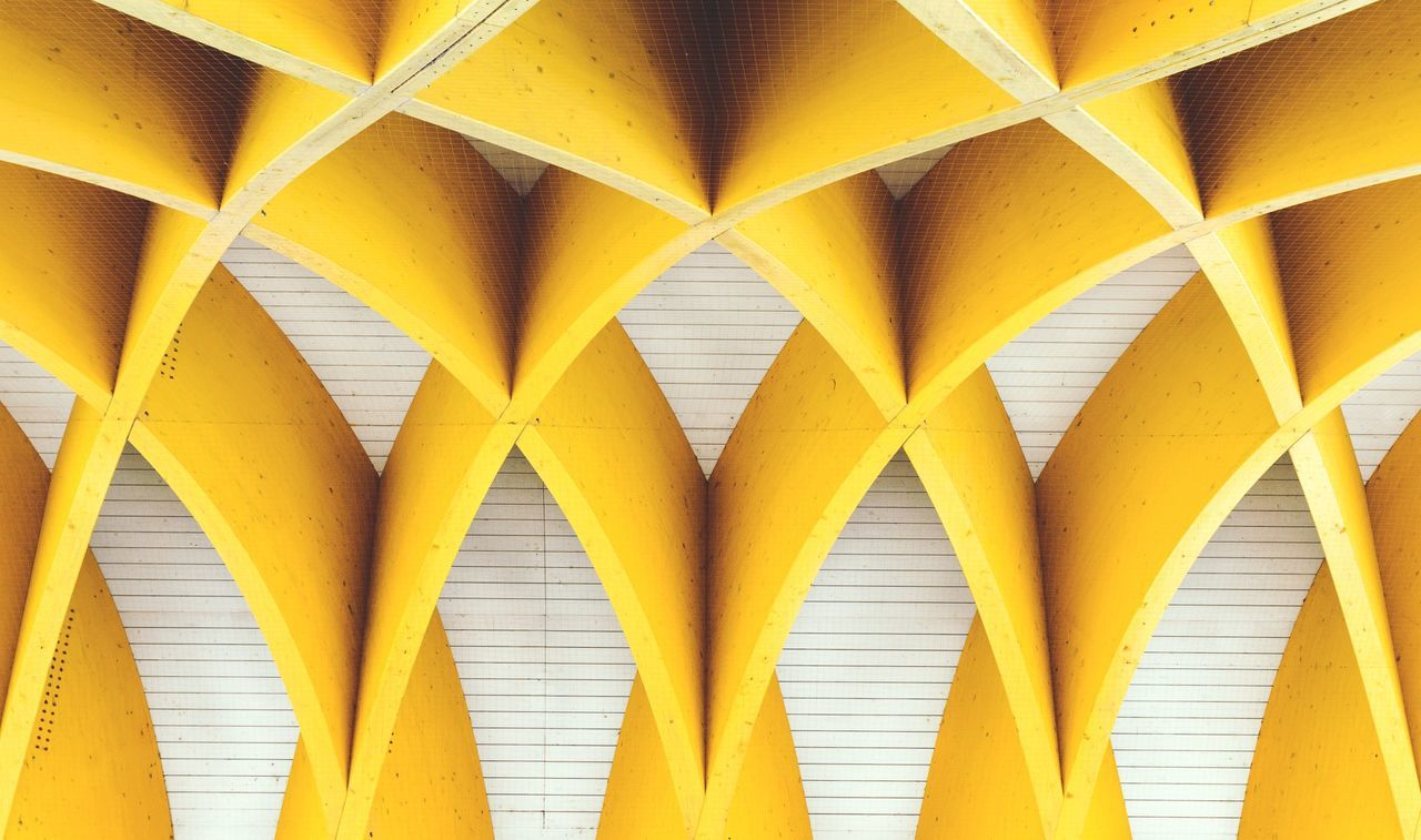 ACV Vienna yellow backgrounds connection abstract symmetry pattern full frame close-up man made object urban Urban geometry geometry no people Architecture day outdoors EyeEmNewHere Vienna Austria symmetrical Architecture Architecture_collection architectural detail