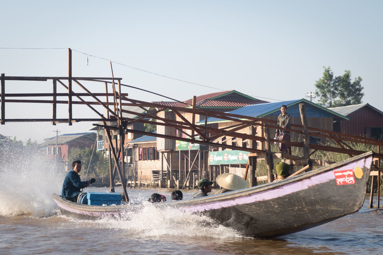 Adult Bamboo Bridge Boats Bridge Burma Day Everyday Lives Inle Lake Longboat Myanmar Nautical Vessel Nyaung Shwe Outdoors People Real People Real People, Real Lives Speeding Transportation Water