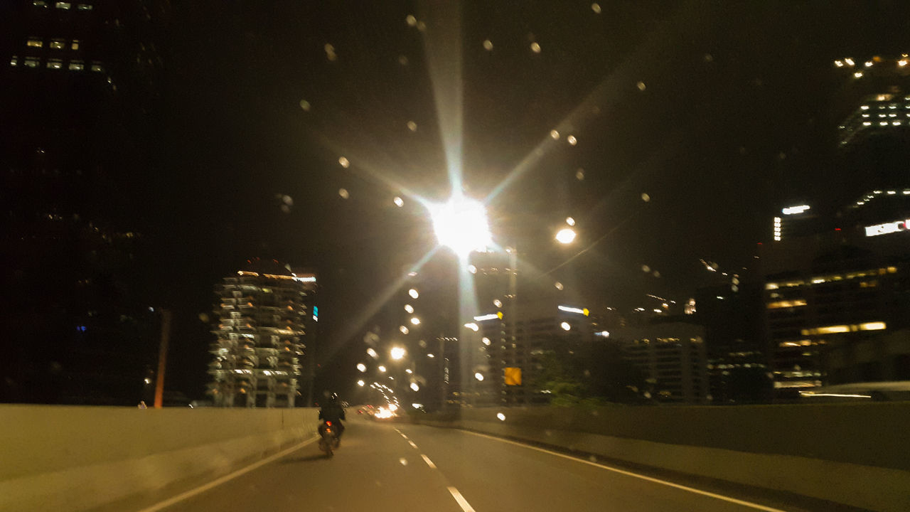 Night. Alone. Road Building Light Effect Speed QuietNight Illuminated City Nightlife City Street Street Architecture Cycling Arts Culture And Entertainment City Life People Bicycle Road Modern One Person Outdoors Full Length Adult Cityscape Popular Music Concert