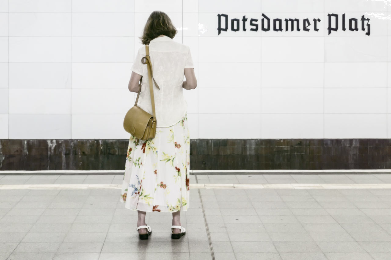 Woman standing on S-Bahn platform 'Potsdamer Platz' 'Potsdmaer Platz' Berlin Germany 🇩🇪 Deutschland S-bahn Standing Woman Color Image Outdoors Platform Unidentified Person Woman Portrait