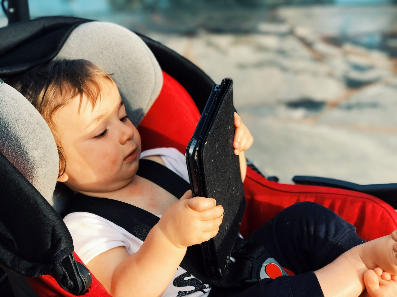 Baby Ipad New Technology Tablet Childhood Car Real People Transportation One Person Boys Day Steering Wheel Toy Car Outdoors Close-up One Boy Only People