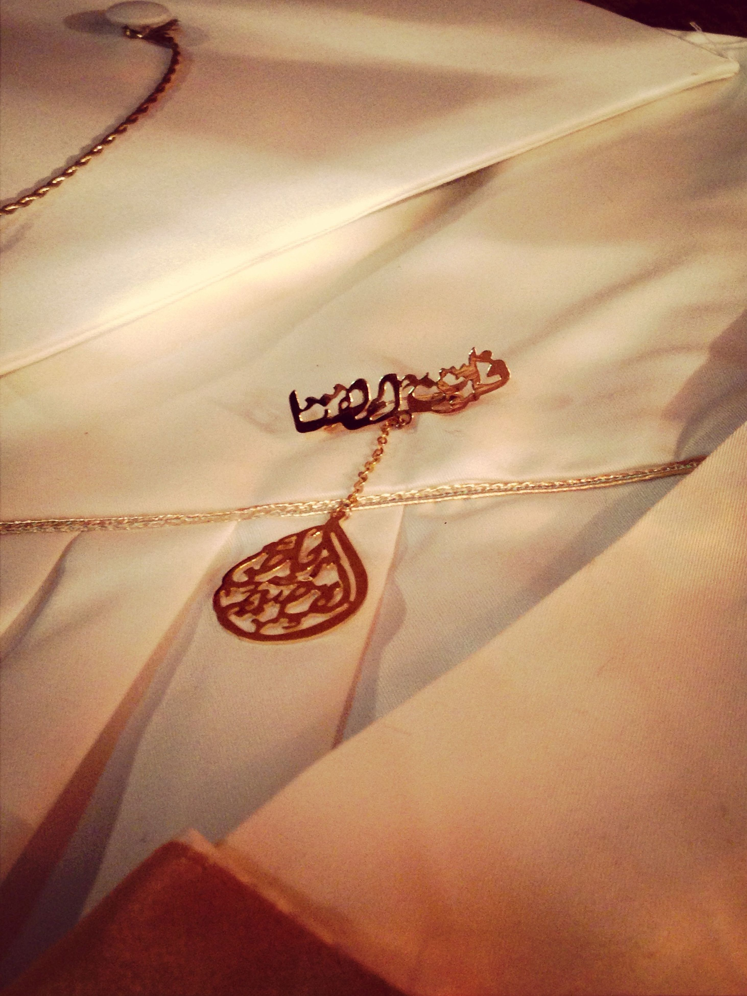 text, western script, indoors, communication, paper, close-up, high angle view, handwriting, message, hanging, heart shape, number, non-western script, table, capital letter, still life, no people, book, textile, love