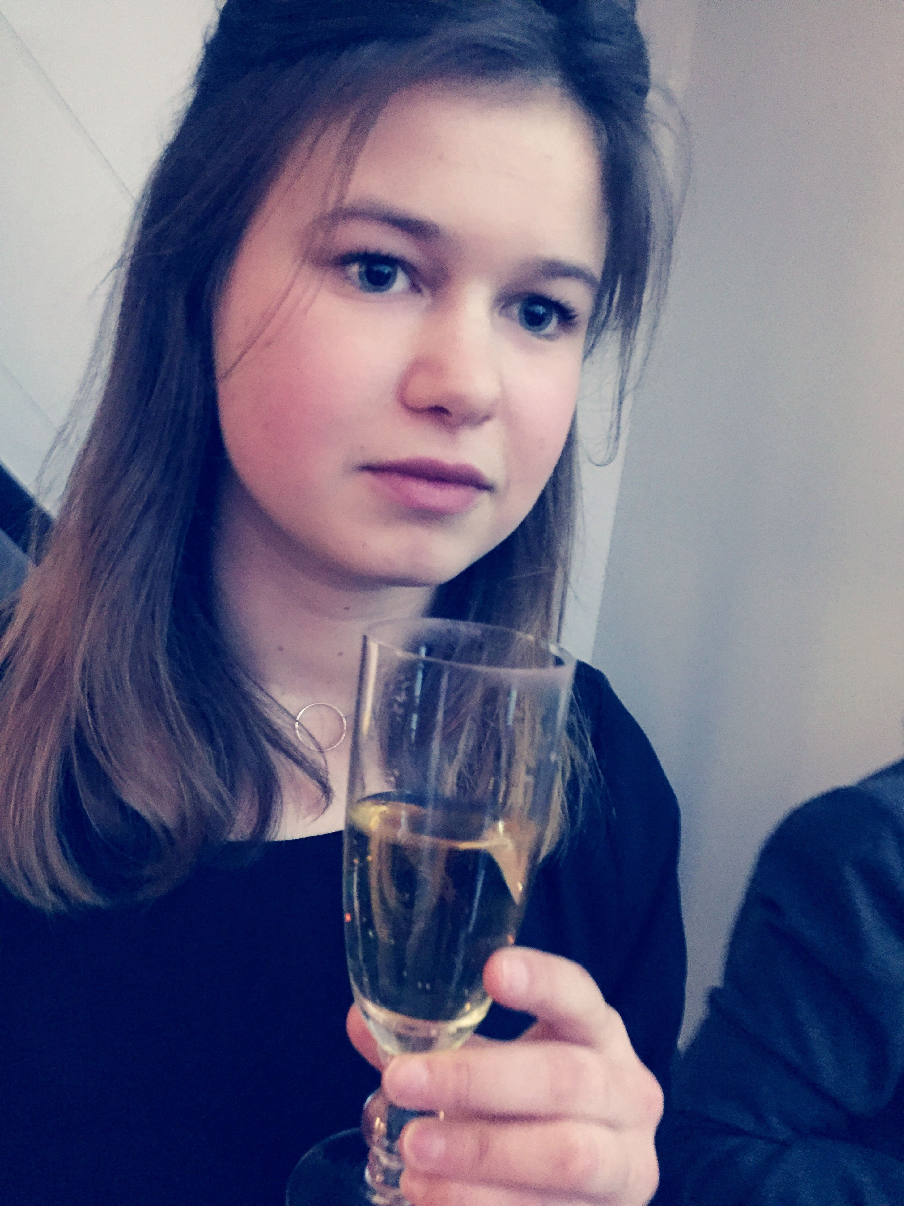 looking at camera, drink, portrait, drinking glass, holding, one person, lifestyles, young women, indoors, young adult, real people, smiling, refreshment, beautiful woman, food and drink, alcohol, close-up, one young woman only, only women, day, people, adult