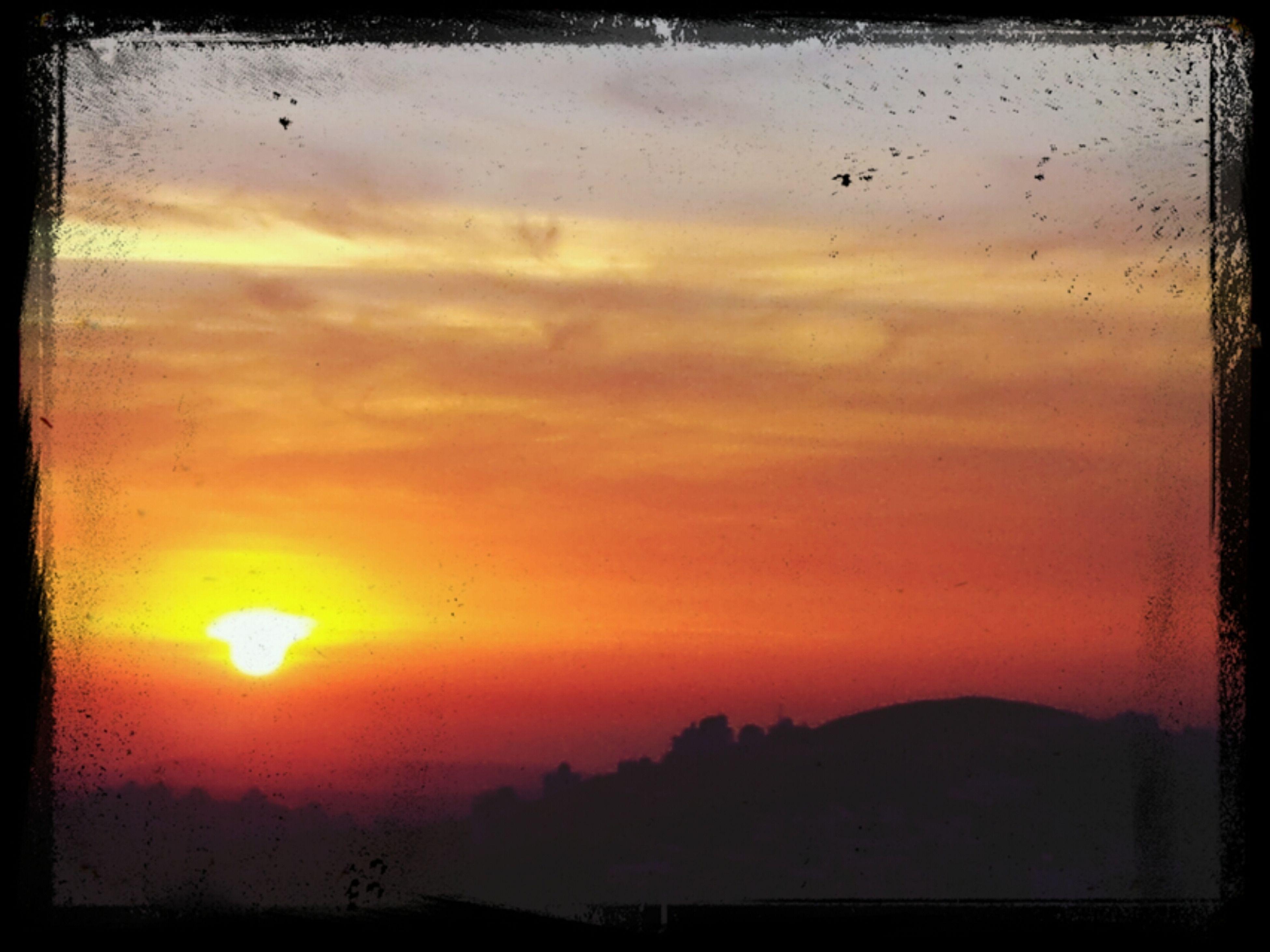 sunset, transfer print, orange color, sky, scenics, silhouette, beauty in nature, tranquil scene, sun, tranquility, auto post production filter, cloud - sky, nature, idyllic, cloud, landscape, dramatic sky, outdoors, sunlight, no people