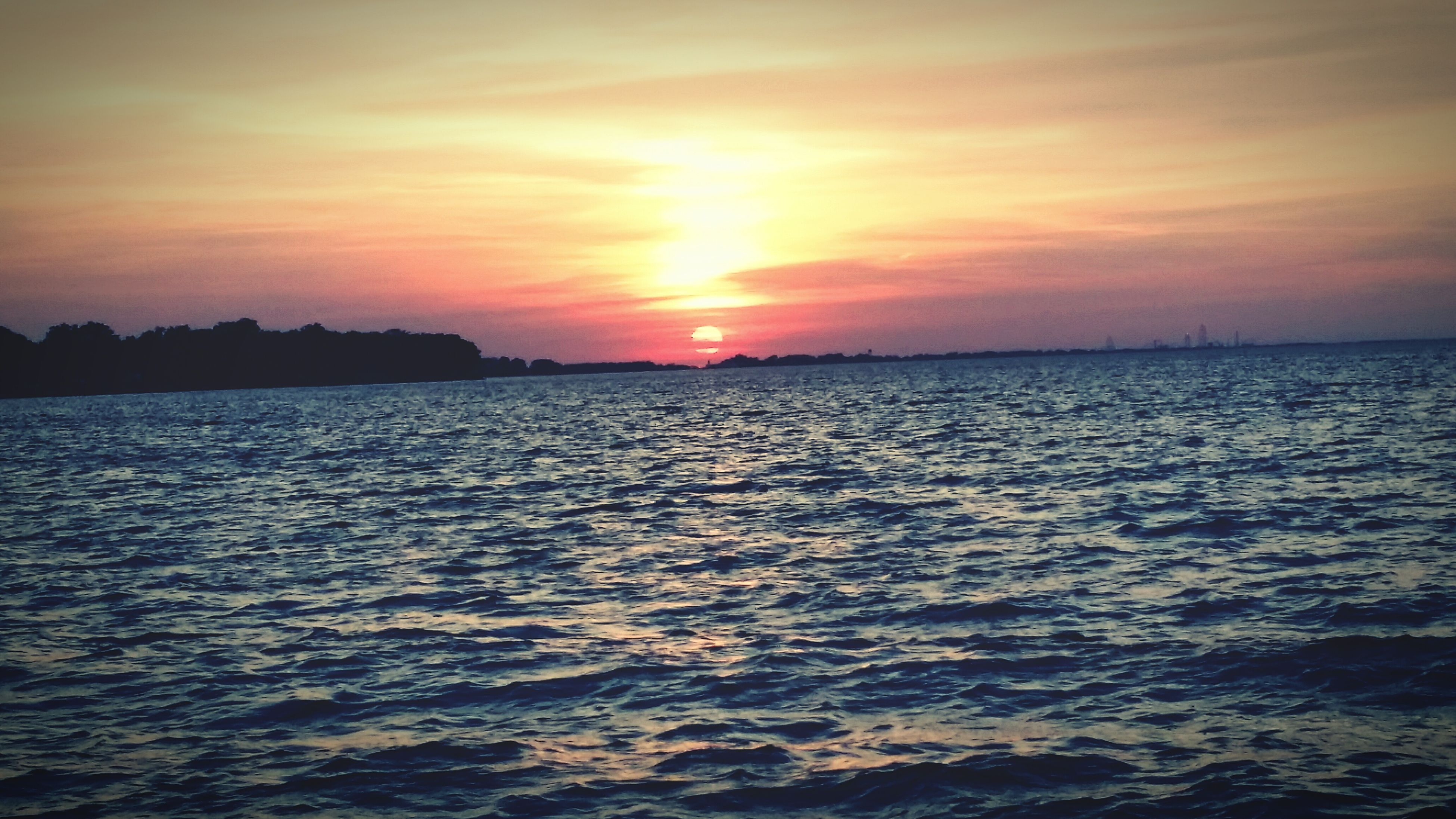 sunset, water, sea, scenics, sun, tranquil scene, beauty in nature, tranquility, sky, waterfront, horizon over water, orange color, rippled, idyllic, nature, reflection, sunlight, cloud - sky, seascape, silhouette