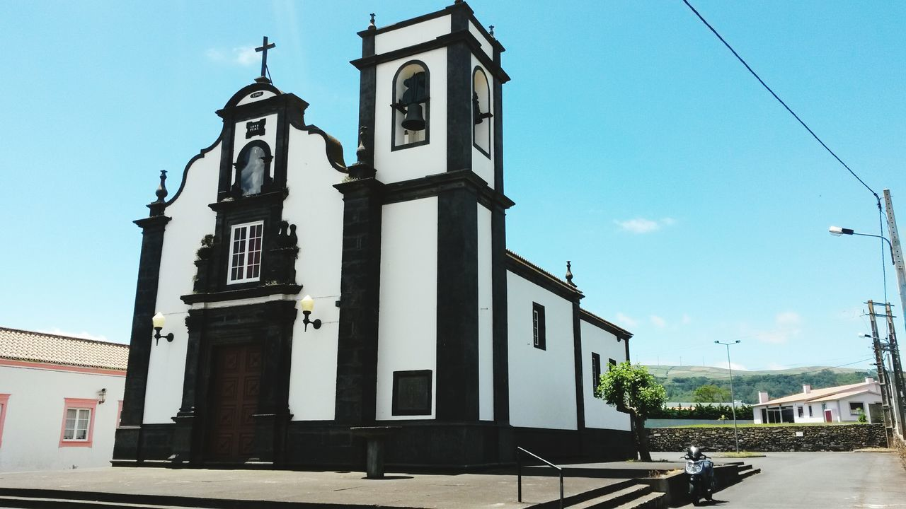 EyeEmNewHere Blue Clear Sky City Architecture Outdoors Travel Destinations Building Exterior Religion Bell Day Clock Tower Sky Bell Tower - Tower Clock Colors Travel Cultures History Church Church Architecture Blackchurch Black Blackdetails Azores