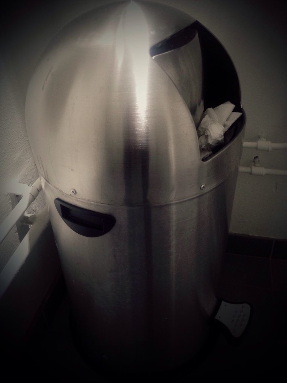Close-Up Of Chrome Garbage Can In Public Restroom