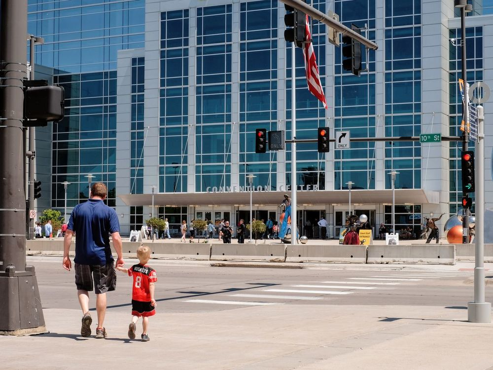2017 Berkshire Hathaway Annual Shareholders Meeting Saturday, May 6, 2017 CenturyLink Center Omaha 455 North 10th Street Downtown Omaha, Nebraska http://www.berkshirehathaway.com/sharehold.html https://finance.yahoo.com/brklivestream Architecture Berkshire Hathaway Building Exterior Built Structure Child Cornhuskers Dad Documentary Documentary Photography Full Length Lifestyles Locals Money Around The World Omaha Omaha, Nebraska Outdoors People Photojournalism Real People Social Issues Son Streetphotography Togetherness Walking Woodstock For Capitalists