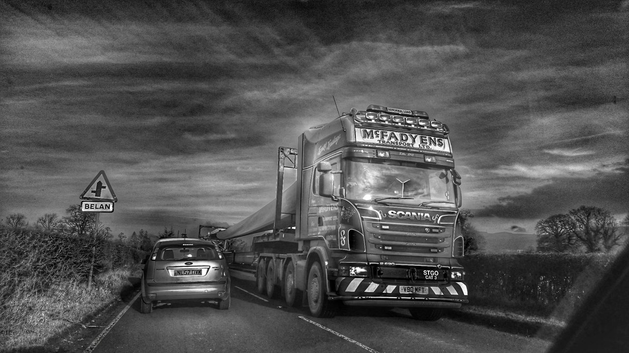 Transportation Road Land Vehicle Sky For The Love Of Black And White Black And White Photography Welsh Countryside Transport Photography Welcome To The Other Dimension Cloud - Sky Turbine Blades Turbine Parts Turbine Transport Heavy Metal Heavy Goods On Her Shoulder Heavey Metal Transporting Aluminium Long Car Live For The Story