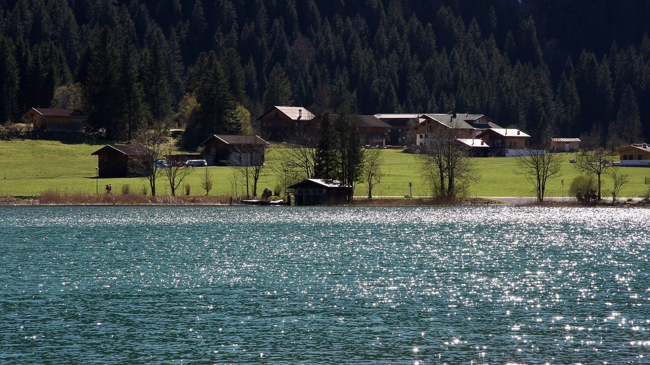 scenic view of lake and village, haldensee Alps Architecture Beach Beauty In Nature Forest Grass Greenery Haldensee Holiday Lake Landscape Life Light Mountain Nature Outdoors Reflection Scenics Spring Tannheimer Tal The Great Outdoors - 2017 EyeEm Awards Tirol  Travel Tree Water