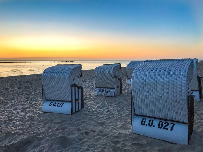 Morning Gold Morning Light Silence Baltic Sea Balticsea Baltic Sea Sellin Ostseebad Sellin Beach Sand Sea Hooded Beach Chair Horizon Over Water Number Water Tranquility Sunset Beauty In Nature No People Shore Sky