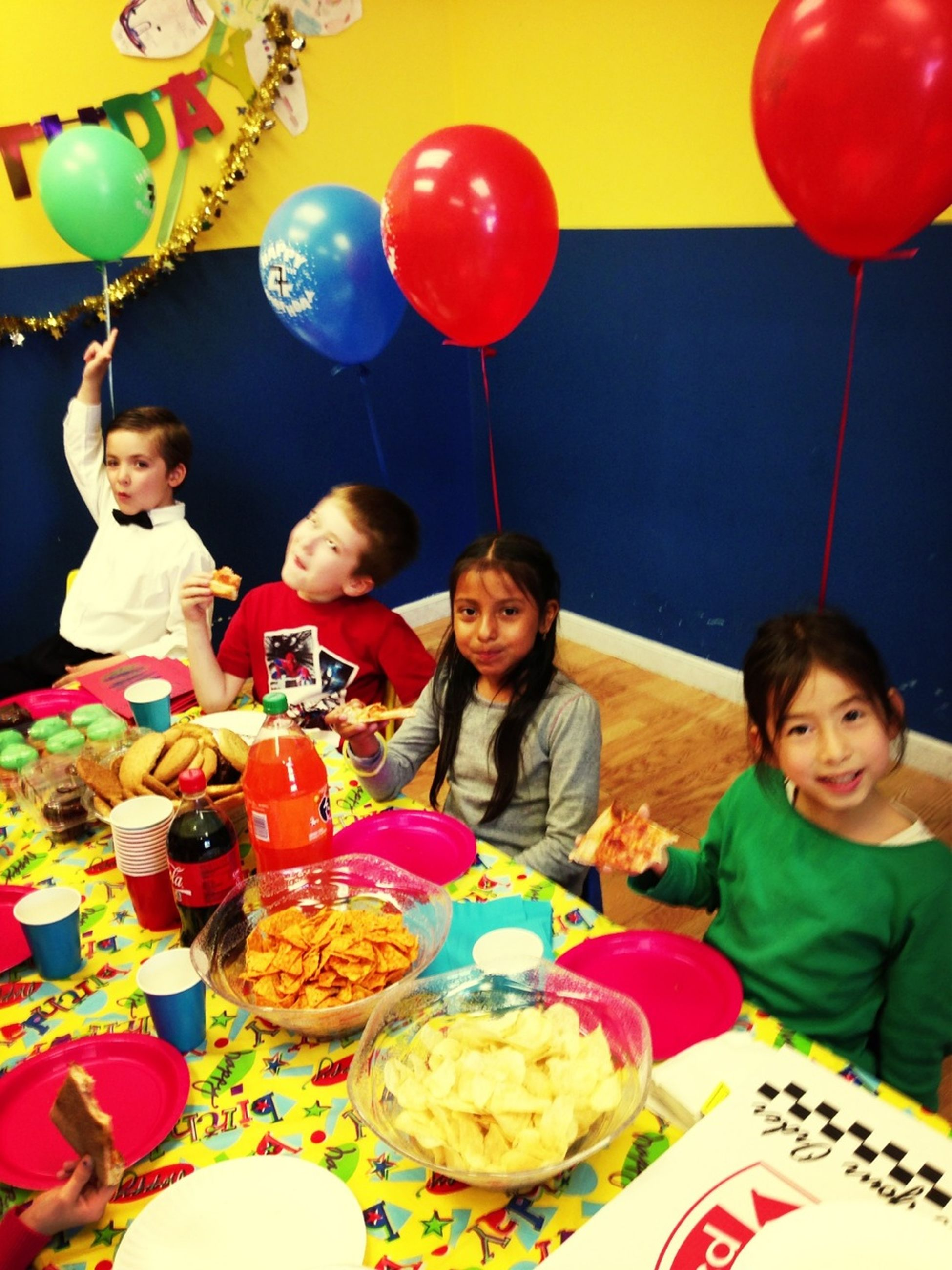 childhood, indoors, celebration, food and drink, leisure activity, elementary age, happiness, balloon, lifestyles, fun, person, food, enjoyment, smiling, togetherness, girls, boys, multi colored, looking at camera