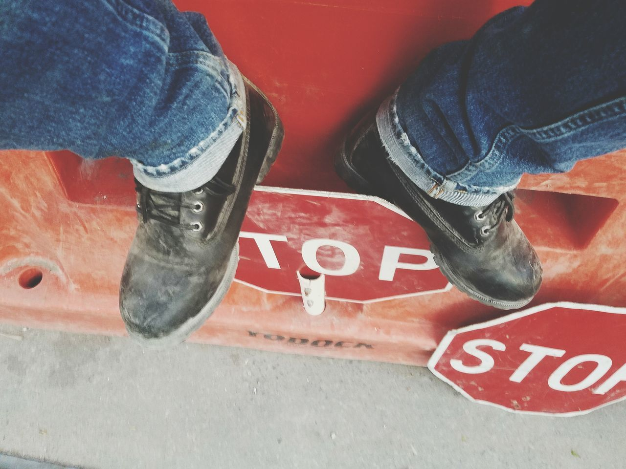 At the top. Hanging Out Top DirtyBoots Construction Sign Stopsign