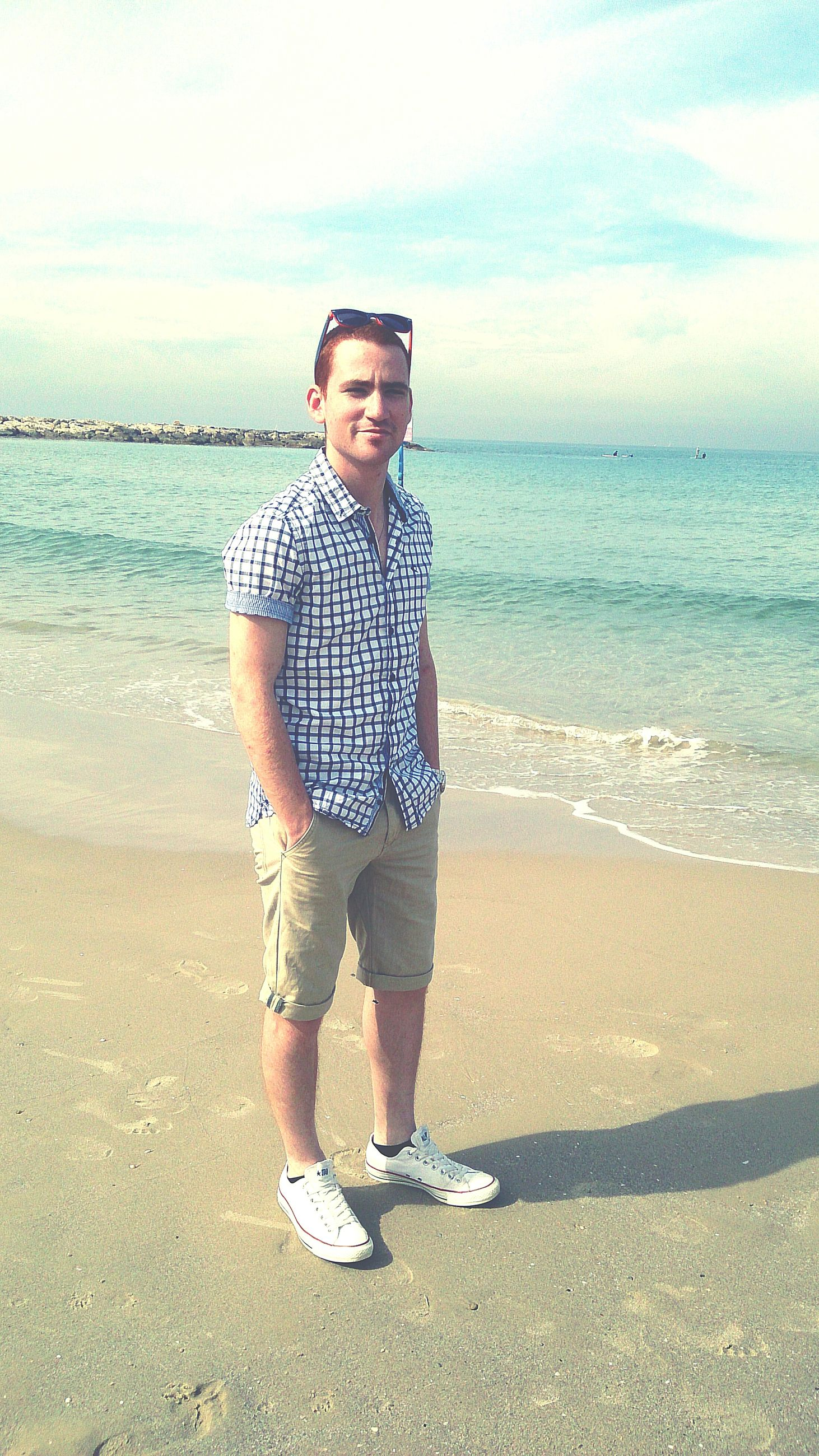 beach, sand, shore, sea, full length, water, casual clothing, lifestyles, person, leisure activity, horizon over water, sky, childhood, portrait, standing, looking at camera, elementary age, front view