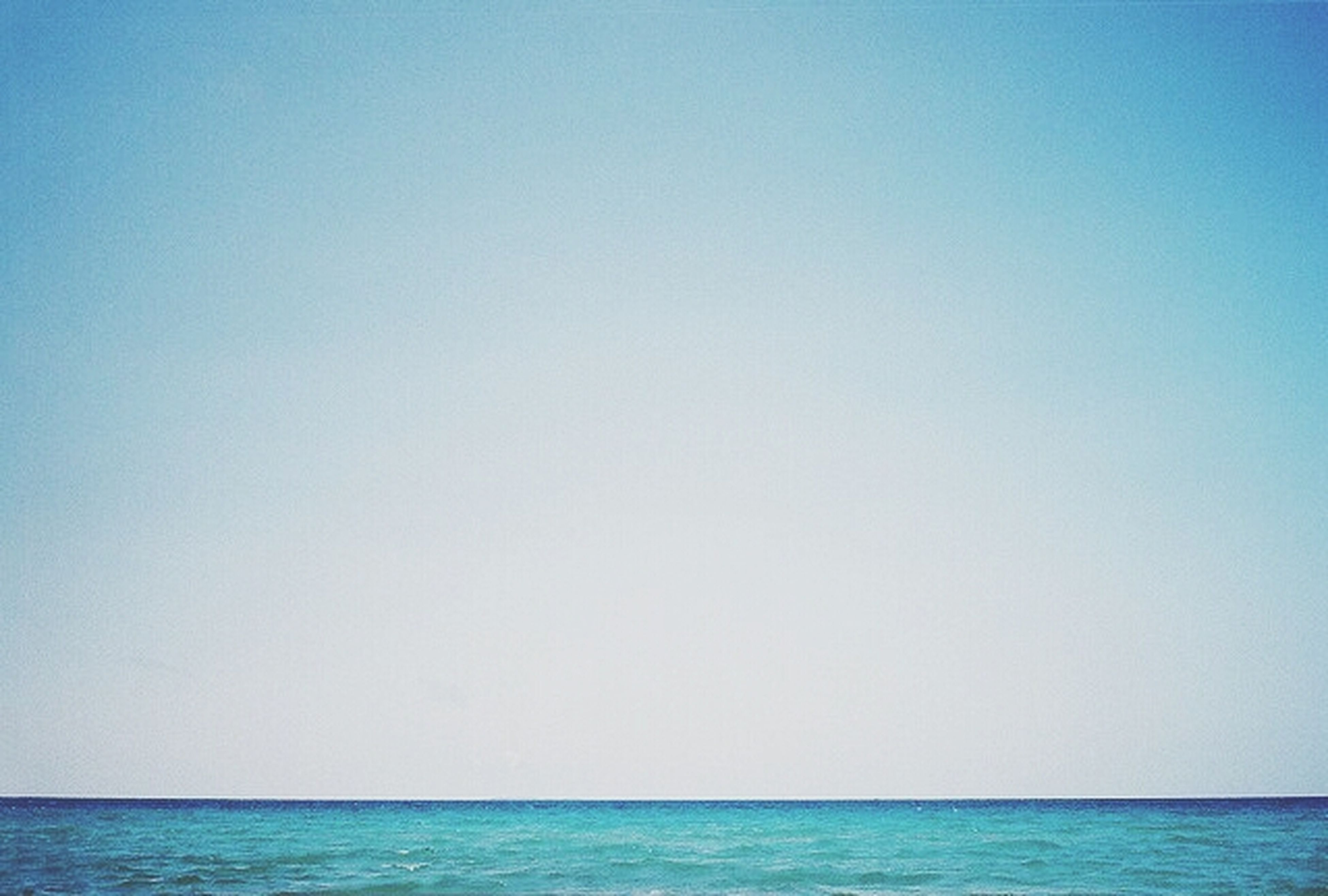 sea, copy space, horizon over water, clear sky, water, blue, tranquil scene, tranquility, scenics, waterfront, beauty in nature, nature, idyllic, seascape, day, remote, outdoors, no people, rippled, calm