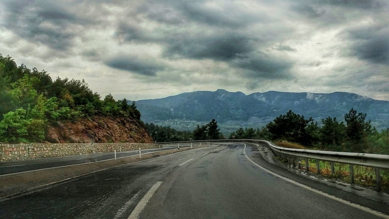 mountain, road, cloud - sky, sky, tree, the way forward, mountain range, nature, transportation, scenics, beauty in nature, day, tranquility, outdoors, tranquil scene, no people, landscape, winding road