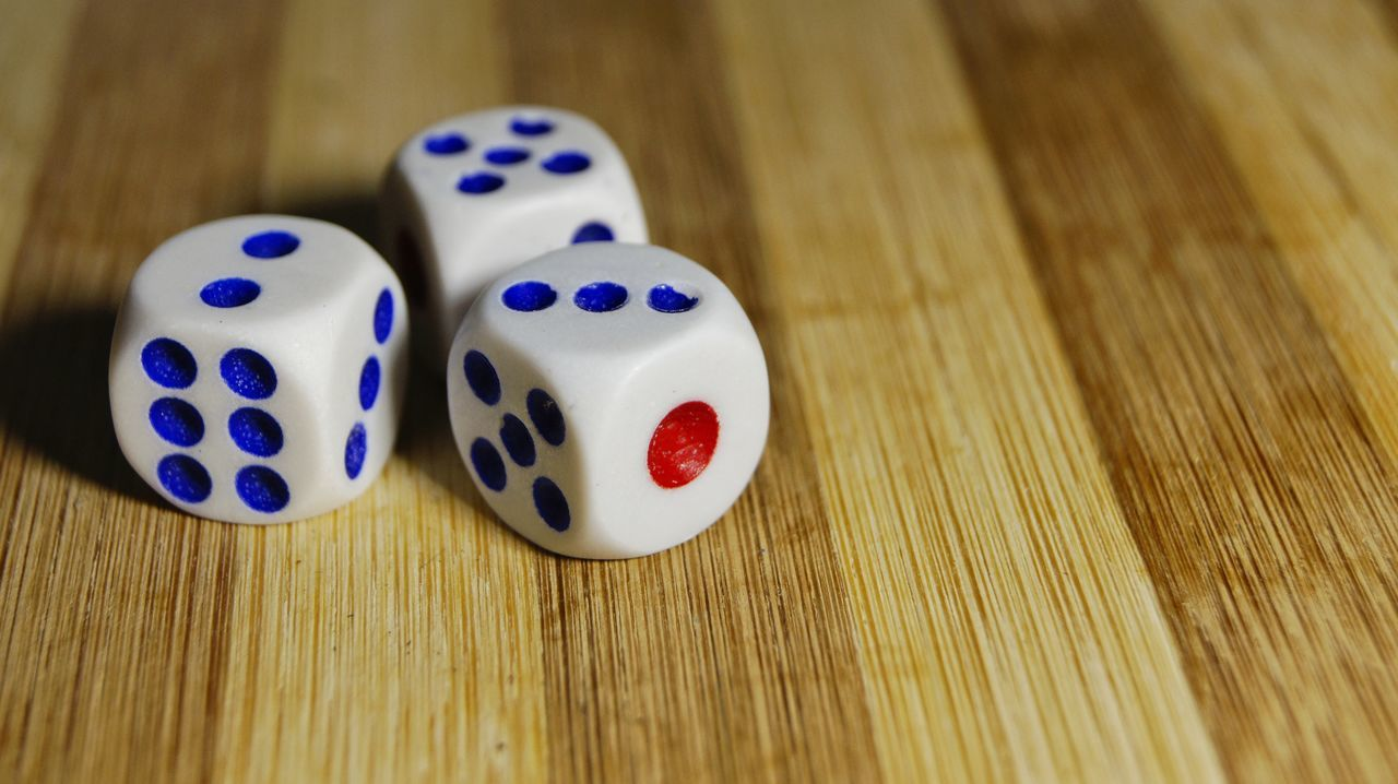 table, dice, gambling, luck, wood - material, chance, indoors, close-up, no people, leisure games, day