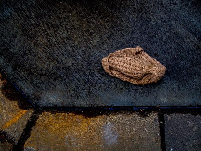 Lost wollen winter hat. Hat Hat On Pavement Lost Hat Lost Winter Hat Lost Wollen Hat No People Still Life Winter Hat Winterhat On Pavement