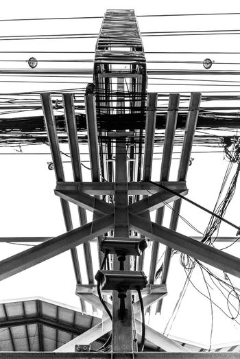 Complexity Architecture Billboard Built Structure Cctv Cctv Camera Clear Sky Complexity Connection Day Electric Wire Electricity  Electricity Pylon Iron - Metal Isolated Low Angle View Modern No People Outdoors Sky Structure Tall Tower Watching White Sky Wires