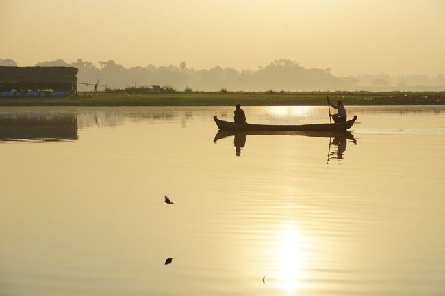 Fishermen Beauty In Nature Boat Calm Cloud Color Palette Lake Mode Of Transport Nature Nautical Vessel Non-urban Scene Outdoors Reflection Scenics Silhouette Sky Standing Water Sun Sunset Swimming Tranquil Scene Tranquility Transportation Water Waterfront