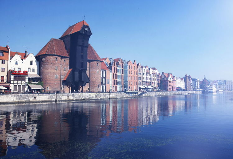 The old town of Gdansk by the Motlawa river with Old Crane Bricks Building Exterior Built Structure Cityscape Crane Famous Place Fog Gothic History Motława Mystery Old Town Postcard Reflection River Summer Travel Destinations Wallpaper