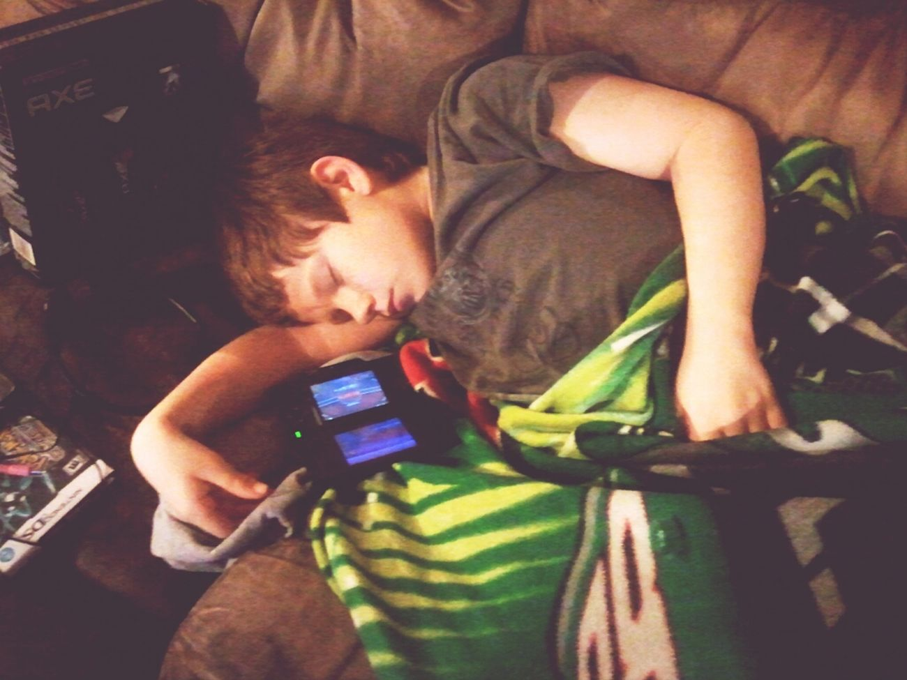 my baby opened all his gifts and the crashed on the couch while playing his game