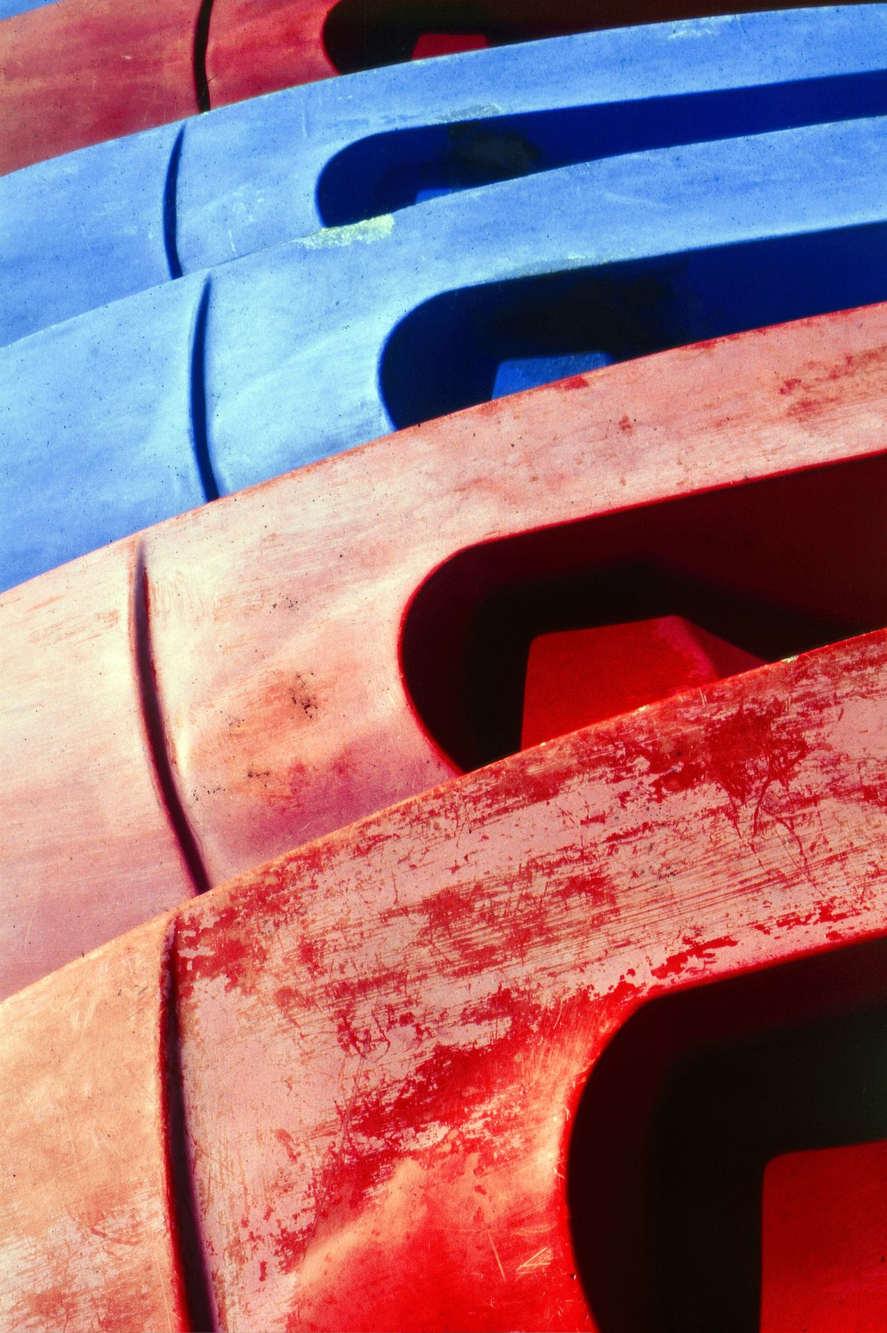 Stacked Canoes, Loutro, Crete, Greece Abstract Photography Blue Canoe Canoes Close-up Colour Colourful Crete Greece Day Fibreglass Flaking Paint Graphic My Point Of View My Style No People Nobody Outdoors Red Shadow Sunlight Textures And Surfaces Travel Photography Vertical