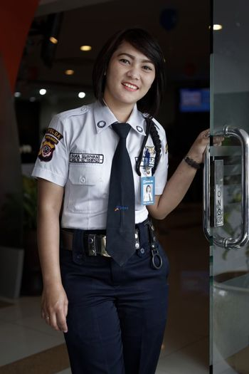Ready to serve Bandung Shooter Indonesian Shooter Cheerful Day Happiness Indoors  Lifestyles Looking At Camera Occupation One Person People Portrait Real People Smiling Standing Uniform Young Adult Young Women