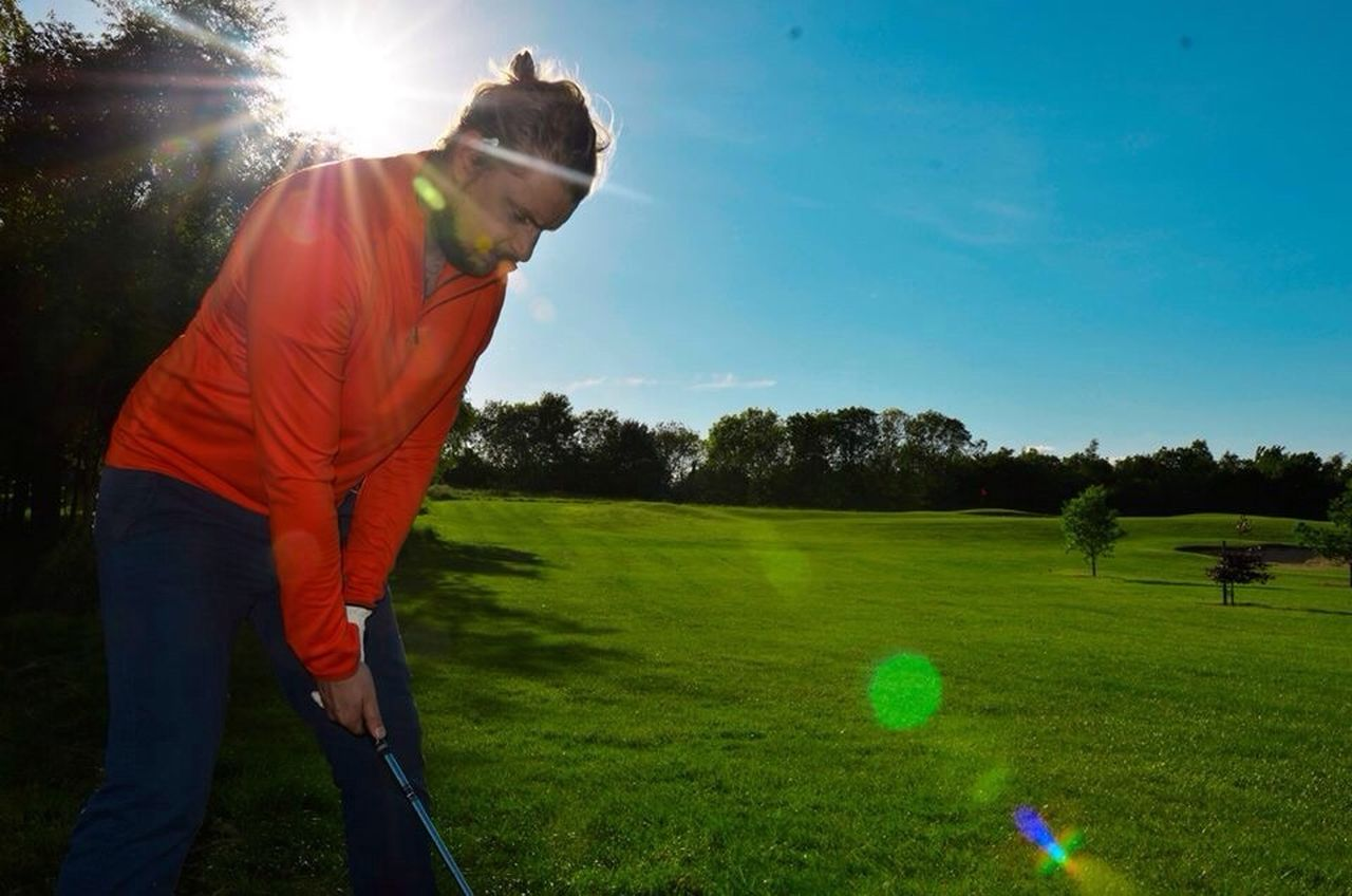 Beautiful stock photos of golf, Blue, Casual Clothing, Caucasian Ethnicity, Concentration