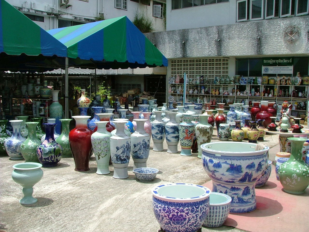 Asia. Building Exterior Built Structure Colourful Vases. Holidays Market Market Market Stall Oriental Porcelain Vases. Porcelain Vases. Shopping Tourism. Variation Vases.