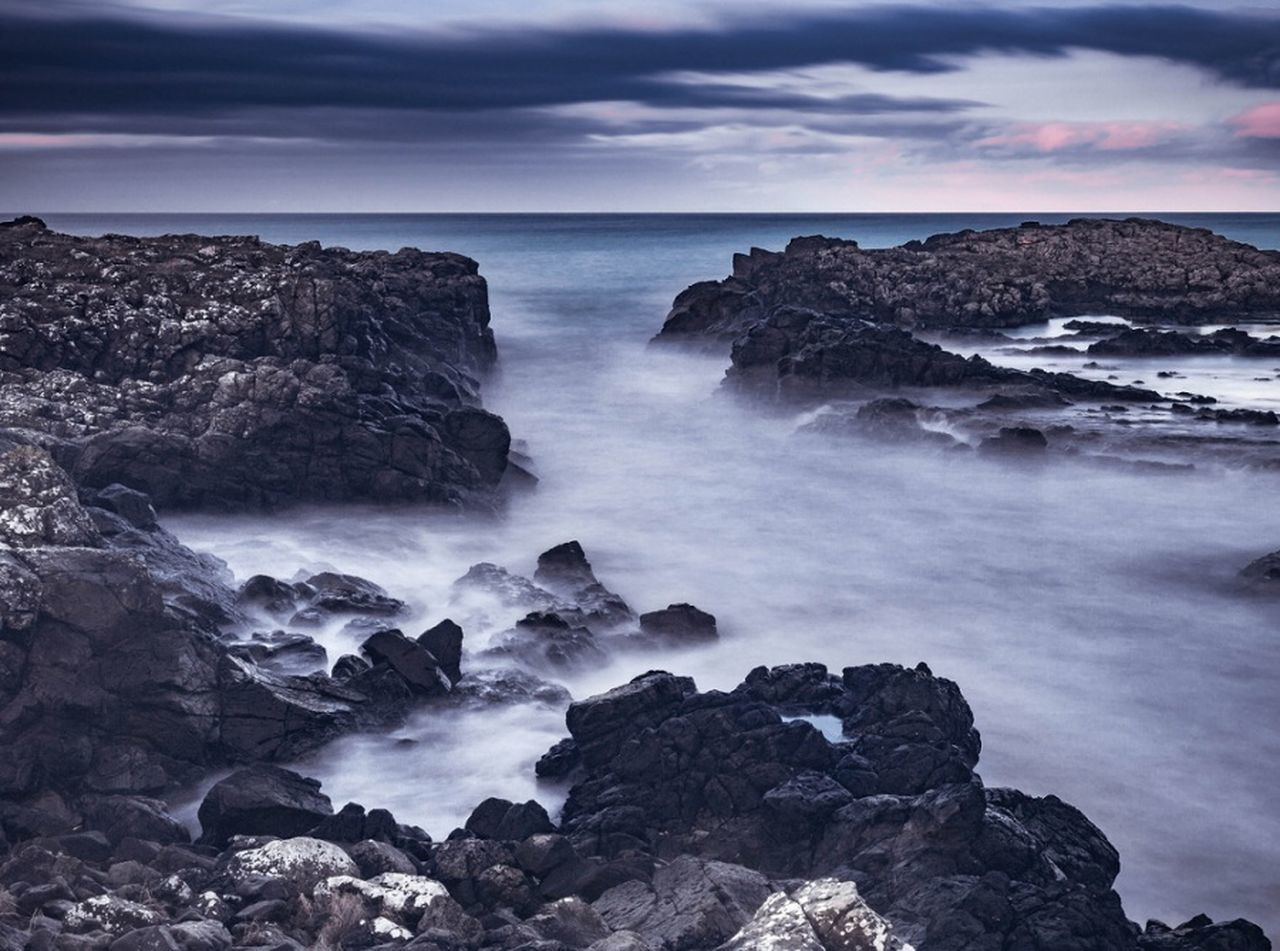 Dunseverick Cloud - Sky Dramatic Sky Travel Sky Nature Sea Scenics Rock - Object Ethereal Idyllic Outdoors Beauty In Nature Water Northcoast Northernireland Travel Long Exposure Long Exposure Photography Sunset Dramatic Waves, Ocean, Nature Travel Destinations
