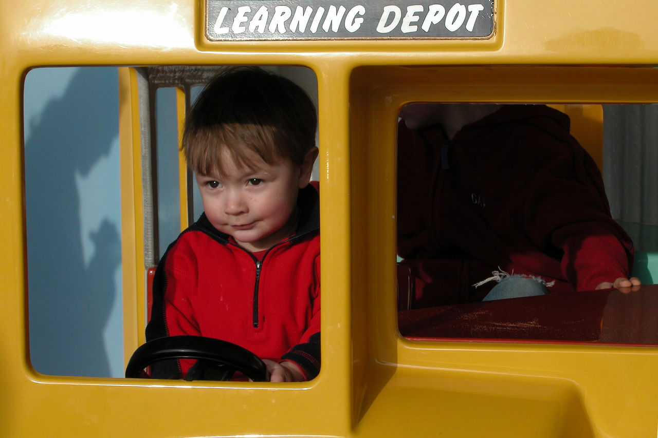 Cute Boy Driving Toy Bus