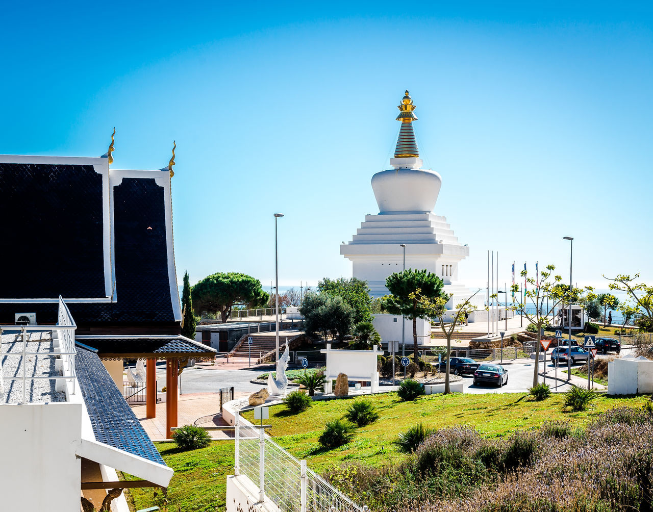Day view of Butterfly Park and The Buddhist Stupa in Benalmadena town. Andalusia, southern Spain Benalmádena, Malaga, Spain Malaga SPAIN Stupa Architecture Blue Sky Buddhism Building Exterior Built Structure Butterfly Park Clear Sky Costa Del Sol Culture Europe Landmark Mariposario Monument No People Outdoors Religion Religious Architecture Spirituality Sunny Day Symbol Tower