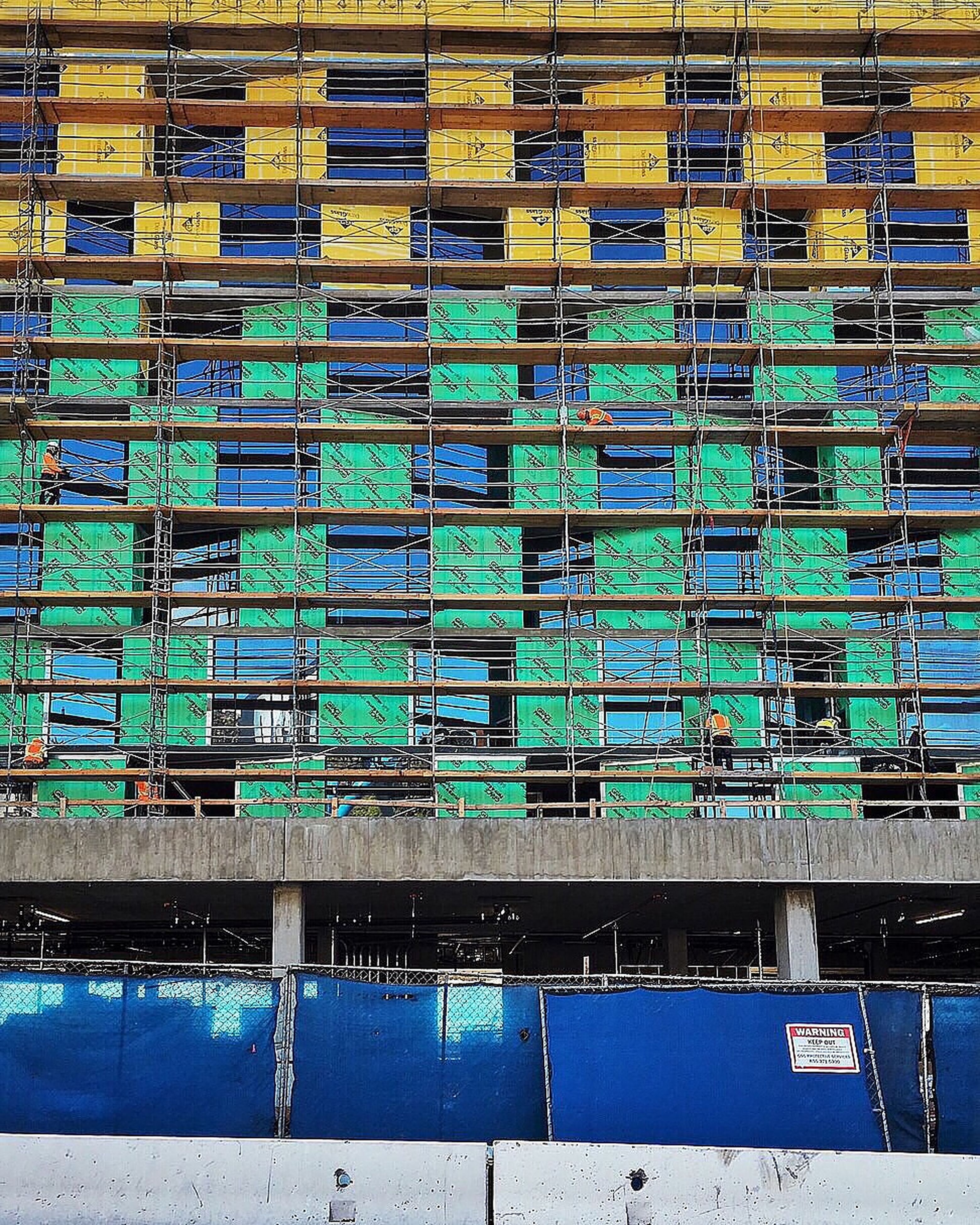 built structure, architecture, building exterior, blue, in a row, full frame, multi colored, backgrounds, outdoors, building, no people, day, repetition, side by side, city, reflection, railing, pattern, wall - building feature, window