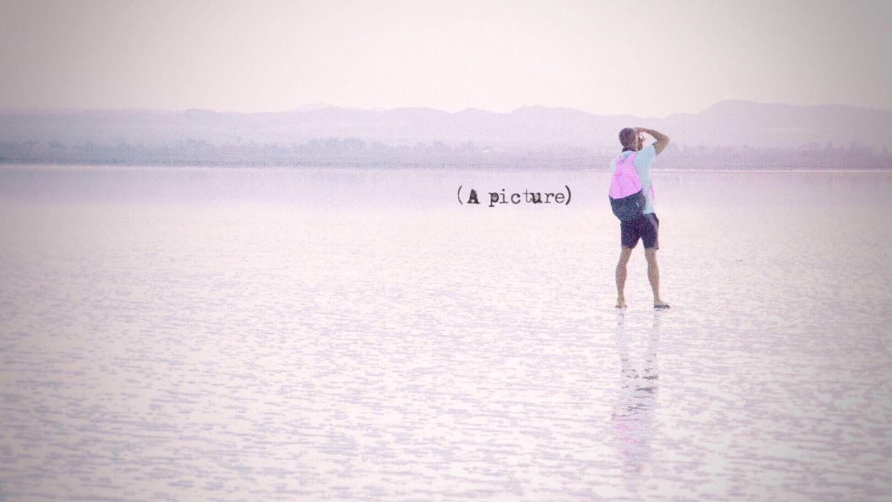 Full Length One Person Lake Water Outdoors Day Sky Nature Beauty In Nature Young Adult People Adult