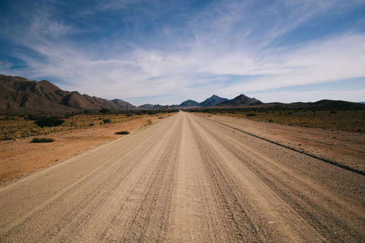 Road Trip Thru Namibia Africa African Cloud Country Road Diminishing Perspective Driving Empty Empty Road Freedom Horizon Over Land Landscape On The Way Nature Open Remote Road Road Road Trip Roadtrip Scenics The Way Forward Tranquil Scene Travel Vanishing Point Wildlife